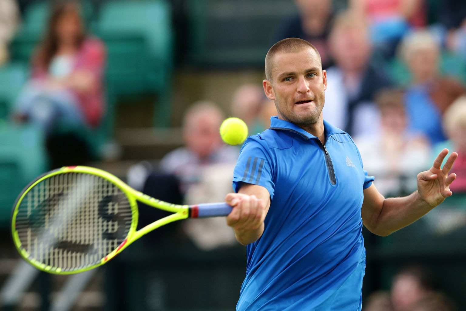 NOTTINGHAM, ENGLAND - JUNE 22:  Mikhail Youzhny of Russia plays a forehand during his men's singles match against Gilles Muller of Luxembourg during day three of the ATP Aegon Open Nottingham at Nottingham Tennis Centre on June 22, 2016 in Nottingham, England.  (Photo by Daniel Smith/Getty Images)