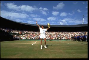 7 JUL 1991:  MICHAEL STICH OF GERMANY HOLDS THE MEN's SINGLES TROPHY UP TO THE CROWD AT THE 1991 WIMBLEDON CHAMPIONSHIPS.