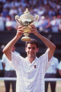 9 JUL 1995:  PETE SAMPRAS OF THE UNITED STATES HOLDS UP THE TROPHY AFTER DEFEATING BORIS BECKE ROF GERMANY IN THE MENS FINAL AT WIMBLEDON. SAMPRS WON THE MATCH 6-7 (2-7), 6-2, 6-4, 6-2. Mandatory Credit: Clive Brunskill/ALLSPORT