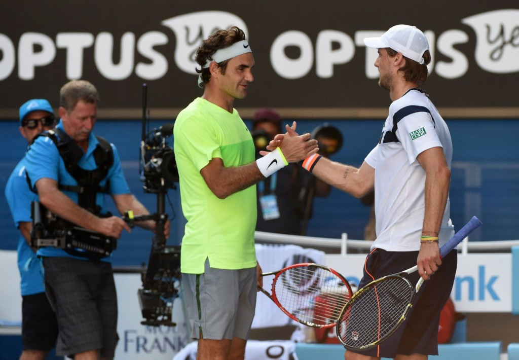 Italy's Andreas Seppi (R) shakes hands as he celebrates after victory in his men's singles match against Switzerland's Roger Federer (L) on day five of the 2015 Australian Open tennis tournament in Melbourne on January 23, 2015. AFP PHOTO / MAL FAIRCLOUGH-- IMAGE RESTRICTED TO EDITORIAL USE - STRICTLY NO COMMERCIAL USE        (Photo credit should read MAL FAIRCLOUGH/AFP/Getty Images)