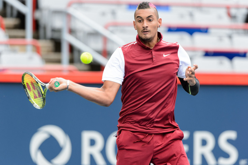 MONTREAL, ON - AUGUST 11:  Nick Kyrgios of Australia returns the ball to Fernando Verdasco of Spain during day two of the Rogers Cup at Uniprix Stadium on August 11, 2015 in Montreal, Quebec, Canada.  (Photo by Minas Panagiotakis/Getty Images)