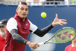 MONTREAL, ON - AUGUST 13:  Nick Kyrgios of Australia hits a return against John Isner of the USA during day four of the Rogers Cup at Uniprix Stadium on August 13, 2015 in Montreal, Quebec, Canada.  (Photo by Minas Panagiotakis/Getty Images)