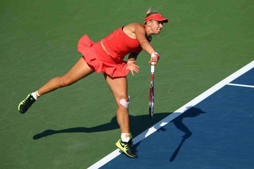 NEW YORK, NY - SEPTEMBER 07:  Sabine Lisicki of Germany serves to Simona Halep of Romania during their Women's Singles Fourth Round match on Day Eight of the 2015 US Open at the USTA Billie Jean King National Tennis Center on September 7, 2015 in the Flushing neighborhood of the Queens borough of New York City.  (Photo by Clive Brunskill/Getty Images)