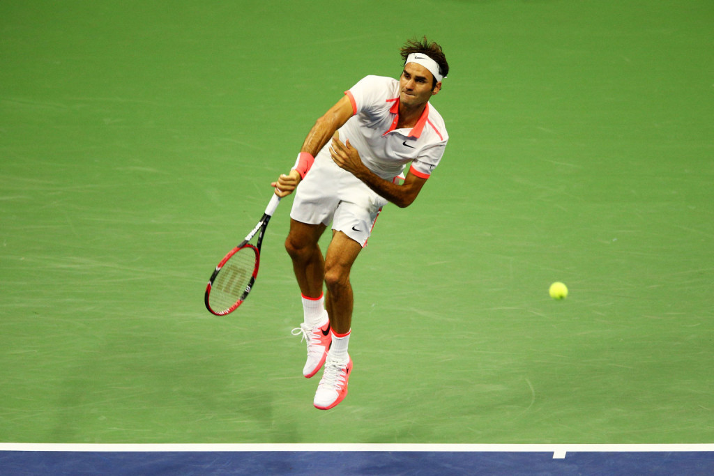 NEW YORK, NY - SEPTEMBER 11:  Roger Federer of Switzerland serves to Stan Wawrinka of Switzerland during their Men's Singles Semifinals match on Day Twelve of the 2015 US Open at the USTA Billie Jean King National Tennis Center on September 11, 2015 in the Flushing neighborhood of the Queens borough of New York City.  (Photo by Clive Brunskill/Getty Images)