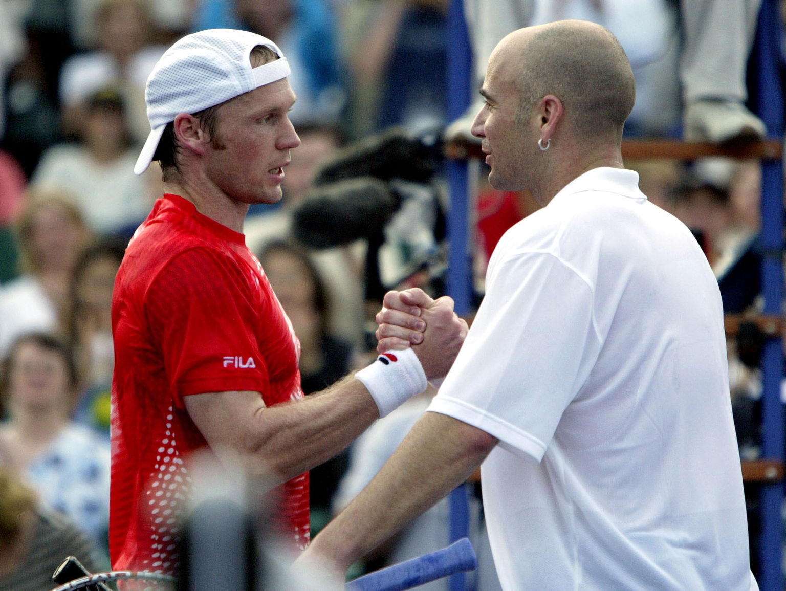 HOUSTON - NOVEMBER 15:  Rainer Schuettler of Germany congratulates Andre Agassi after their match during the Tennis Masters Cup November 15, 2003 at the Westside Tennis Club in Houston, Texas.  (Photo by Clive Brunskill/Getty Images)