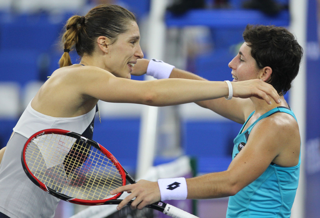 ZHUHAI, CHINA - NOVEMBER 04:  Carla Suarez Navarro (R) of Spain hugs with Andrea Petkovic of Germany after their match on day 3 of Huajin Securities WTA Elite Trophy Zhuhai at Hengqin Tennis Center on November 4, 2015 in Zhuhai, China.  (Photo by Zhong Zhi/Getty Images)