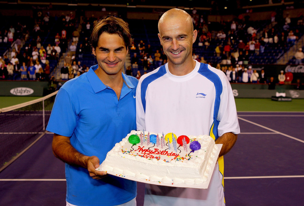 INDIAN WELLS, CA - MARCH 19: Roger Federer of Switzerland presents Ivan Ljubicic of Croatia a cake for his 29th birthday after their match during the Pacific Life Open at the Indian Wells Tennis Garden March 19, 2008 in Indian Wells, California.  (Photo by Matthew Stockman/Getty Images)