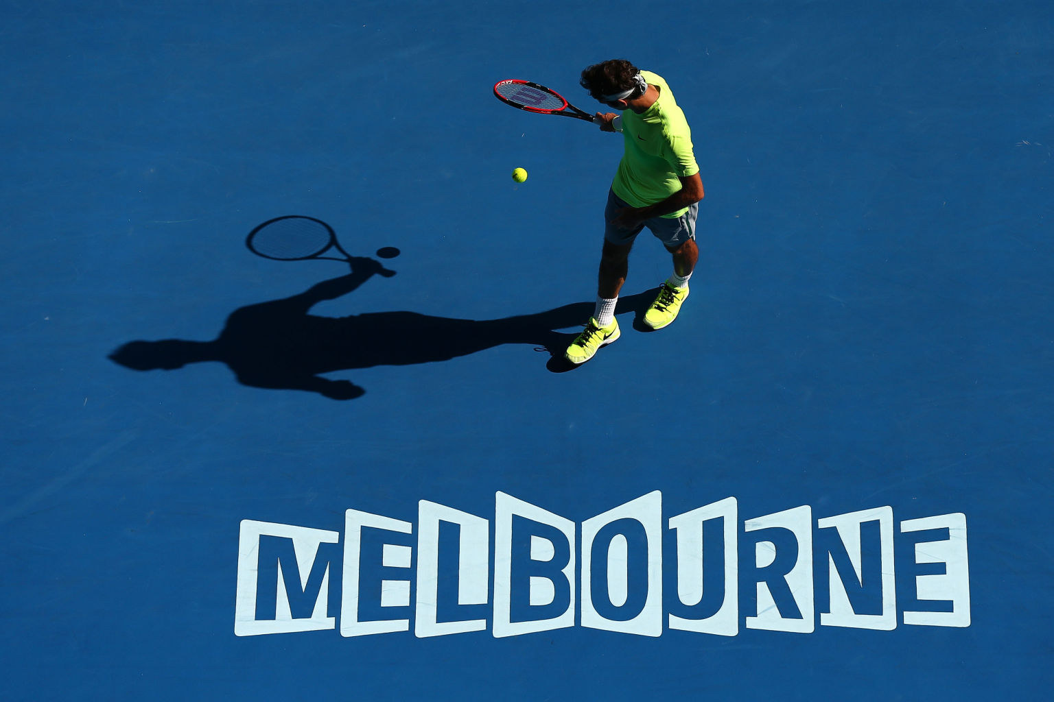 XXX of ZZZZ plays a forehand in his/her third round match against XXXX of ZZZZZ during day five of the 2015 Australian Open at Melbourne Park on January 23, 2015 in Melbourne, Australia.