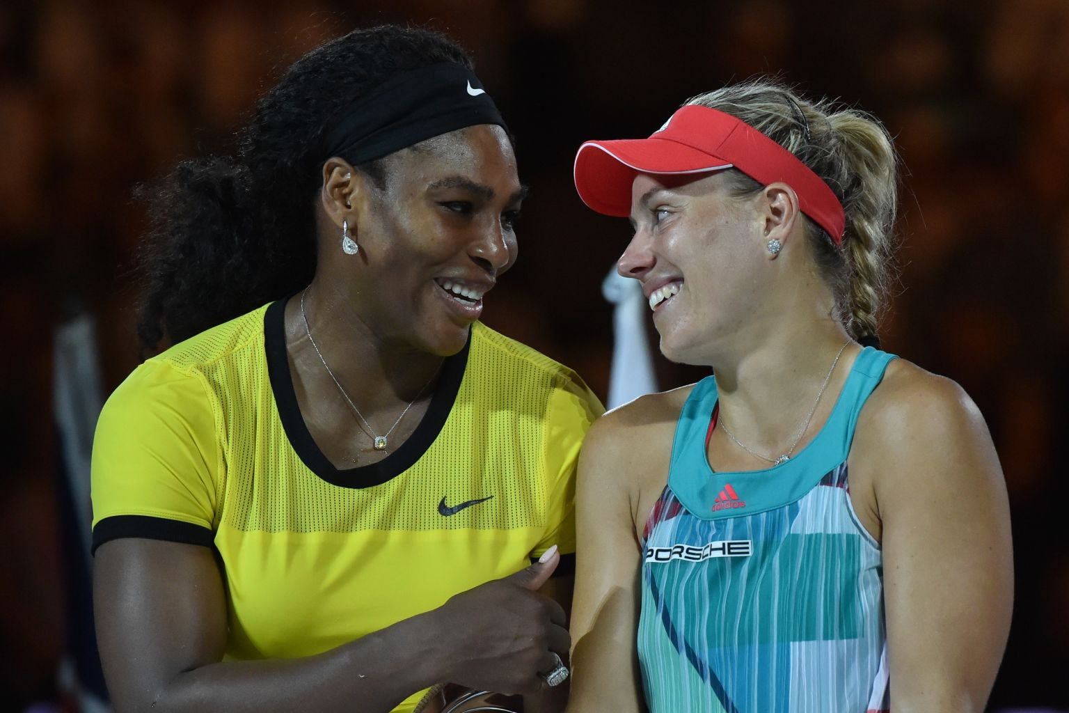 Angelique Kerber of Germany (R) is congratulated during the awards ceremony by Serena Williams of the US (L) after Kerber's victory in their women's singles final match on day 13 of the 2016 Australian Open tennis tournament in Melbourne on January 30, 2016. AFP PHOTO / PAUL CROCK -- IMAGE RESTRICTED TO EDITORIAL USE - STRICTLY NO COMMERCIAL USE / AFP / PAUL CROCK        (Photo credit should read PAUL CROCK/AFP/Getty Images)