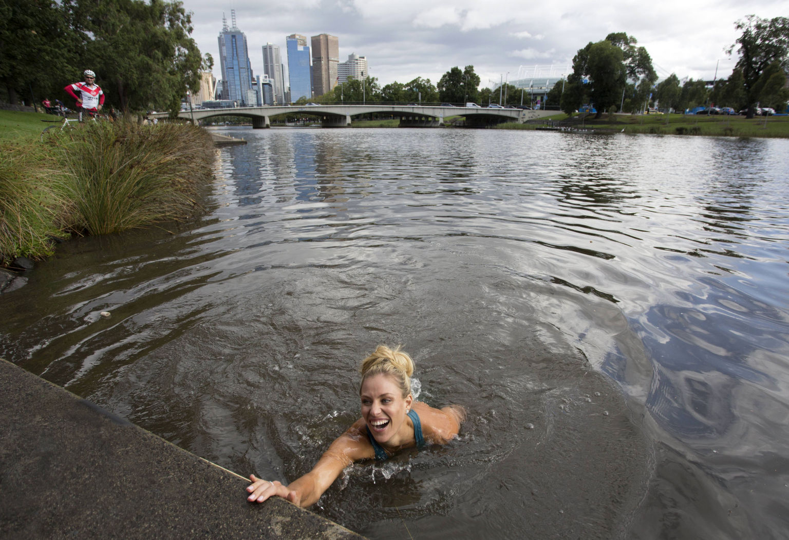 MELBOURNE, VICTORIA - JANUARY 31:  In this handout photo provided by Tennis Australia, Angelique Kerber of Germany jumps into the Yarra River on day 14 of the 2016 Australian Open at Melbourne Park on January 31, 2016 in Melbourne, Australia. Kerber defeated Serena Williams of the United States to win the Australian Women's Singles Final. (Photo by Fiona Hamilton/Tennis Australia via Getty Images)