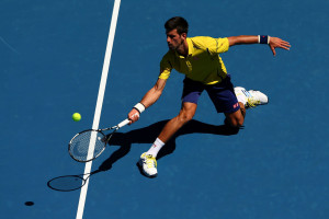 MELBOURNE, AUSTRALIA - JANUARY 18:  Novak Djokovic of Serbia plays a forehand in his first round match against Hyeon Chung of Korea during day one of the 2016 Australian Open at Melbourne Park on January 18, 2016 in Melbourne, Australia.  (Photo by Cameron Spencer/Getty Images)