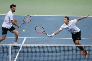 HANOVER, GERMANY - MARCH 05:  Philipp Petzschner and Philipp Kohlschreiber of Germany in action against Tomas Berdych and Radek Stepanek of Czech Republic in their doubles match during day two of the Davis Cup World Group first round between Germany and Czech Republic at TUI Arena on March 5, 2016 in Hanover, Germany.  (Photo by Oliver Hardt/Bongarts/Getty Images)