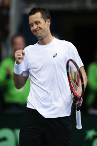 HANOVER, GERMANY - MARCH 06:  Philipp Kohlschreiber of Germany celebrate his match point in his match against Tomas Berdych of Czech Republic during Day 3 of the Davis Cup World Group first round between Germany and Czech Republic on March 6, 2016 in Hanover, Germany.  (Photo by Oliver Hardt/Bongarts/Getty Images)