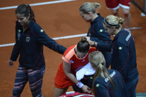 STUTTGART, GERMANY - APRIL 22:  Andrea Petkovic of Germany takes comfort of her teammates after being defeated by Samantha Stosur of Australia during day two of the Federation Cup 2012 World Group Play-Off match between Germany and Australia at Porsche Arena on April 22, 2012 in Stuttgart, Germany.  (Photo by Dennis Grombkowski/Bongarts/Getty Images)