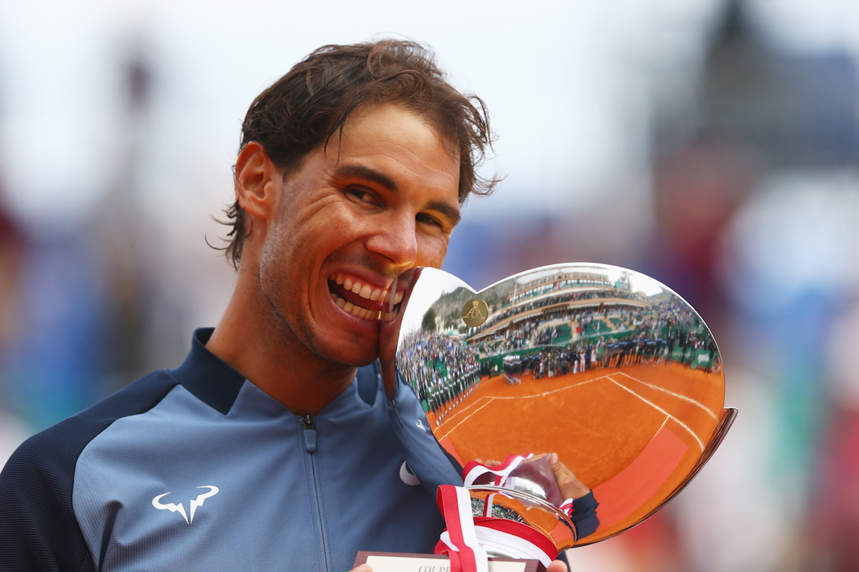 MONTE-CARLO, MONACO - APRIL 17:  Rafael Nadal of Spain celebrates with the trophy after victory in the singles final match against Gael Monfils of France during day eight of the  Monte Carlo Rolex Masters at Monte-Carlo Sporting Club on April 17, 2016 in Monte-Carlo, Monaco.  (Photo by Michael Steele/Getty Images)