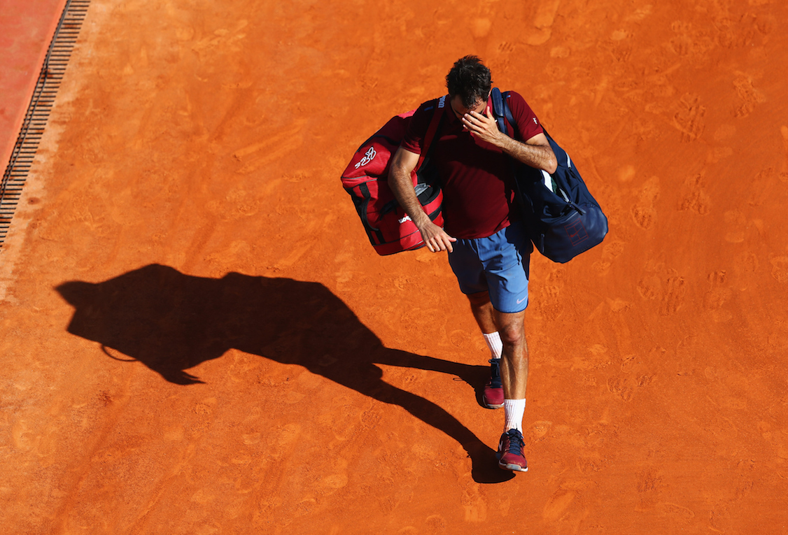 MONTE-CARLO, MONACO - APRIL 15:  Roger Federer of Switzerland reacts after defeat in the quarter final match against Jo-Wilfried Tsonga of France on day six of the Monte Carlo Rolex Masters at Monte-Carlo Sporting Club on April 15, 2016 in Monte-Carlo, Monaco.  (Photo by Michael Steele/Getty Images)