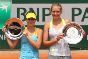 PARIS, FRANCE - JUNE 08:  (L-R) Winner Belinda Bencic of Switzerland and runner up  Antonia Lottner of Germany pose with their trophies after the girls' singles final match during day fourteen of French Open at Roland Garros on June 8, 2013 in Paris, France.  (Photo by Clive Brunskill/Getty Images)