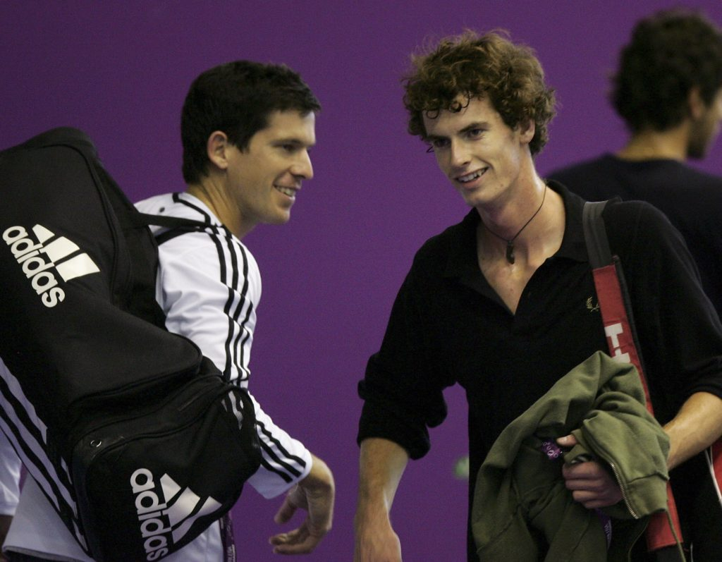 MADRID, SPAIN - OCTOBER 15: Tim Henman (L) and Andy Murray (R) pass each other on the practice courts before their first round matches in the next two days at the ATP Madrid Masters at the Nuevo Rockodromo October 15, 2006 in Madrid, Spain. (Photo by Julian Finney/Getty Images)