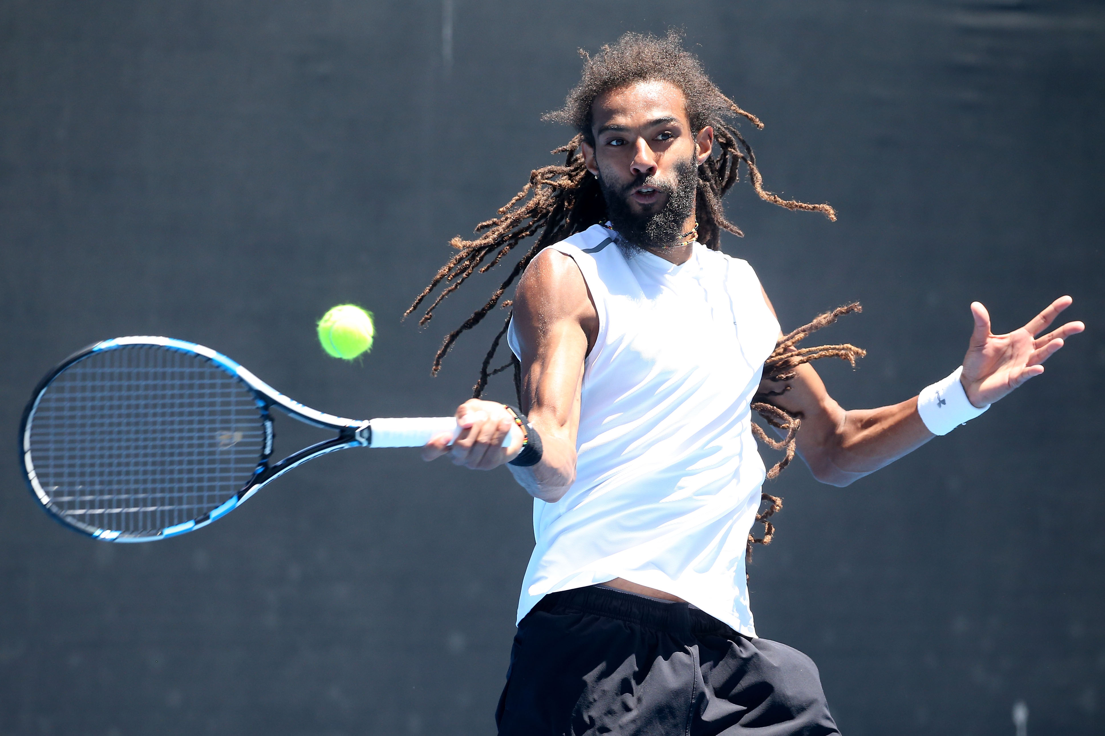 MELBOURNE, AUSTRALIA - JANUARY 19:  Dustin Brown of Germany plays a forehand in his first round doubles match with Albert Ramos-Vinolas of Spain against Nenad Zimonjic and Mischa Zverev on day four of the 2017 Australian Open at Melbourne Park on January 19, 2017 in Melbourne, Australia.  (Photo by Pat Scala/Getty Images)