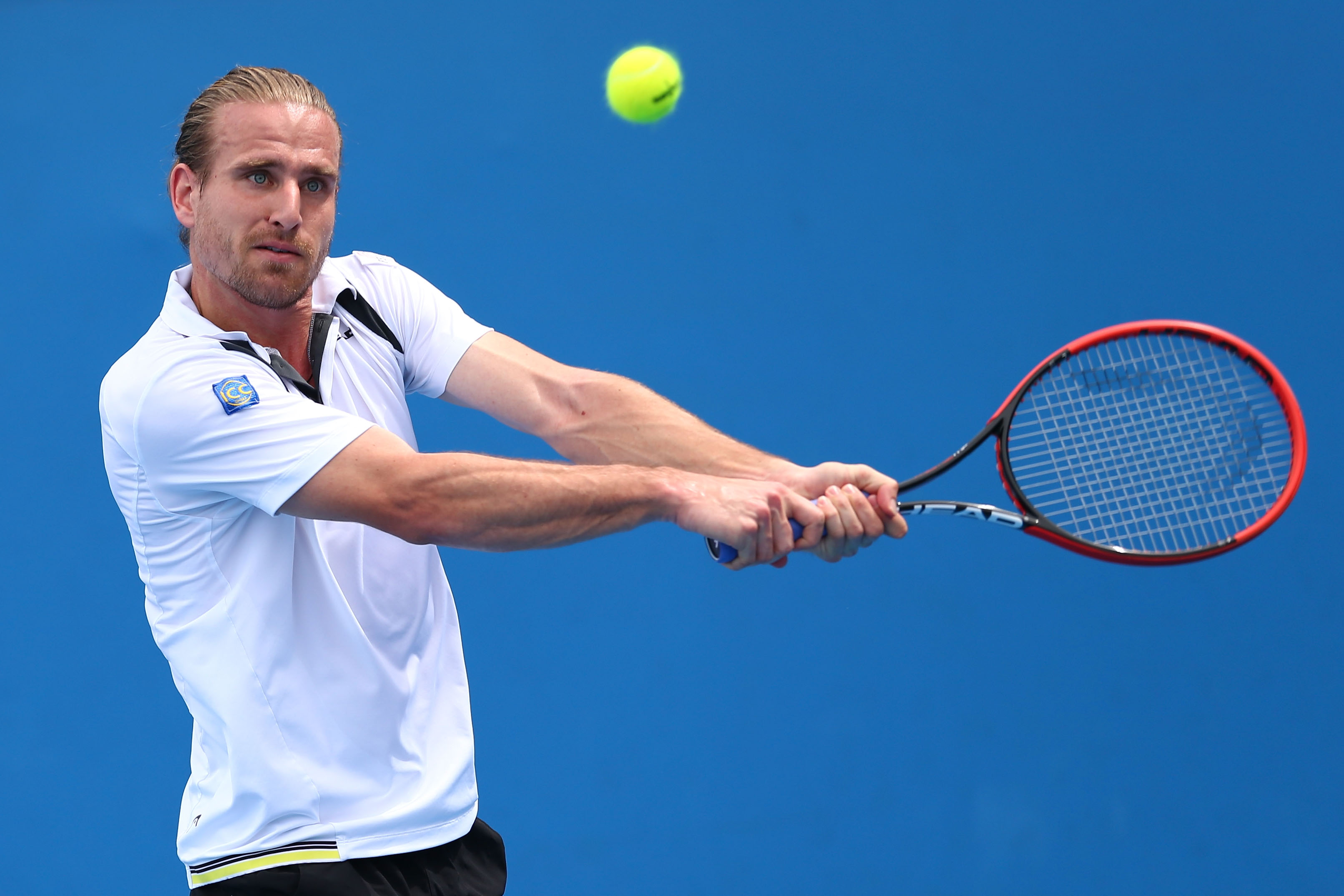 MELBOURNE, AUSTRALIA - JANUARY 20: Peter Gojowczyk of Germany plays a backhand in his first round match against Guillermo Garcia-Lopez of Spain during day two of the 2015 Australian Open at Melbourne Park on January 20, 2015 in Melbourne, Australia. (Photo by Ryan Pierse/Getty Images)