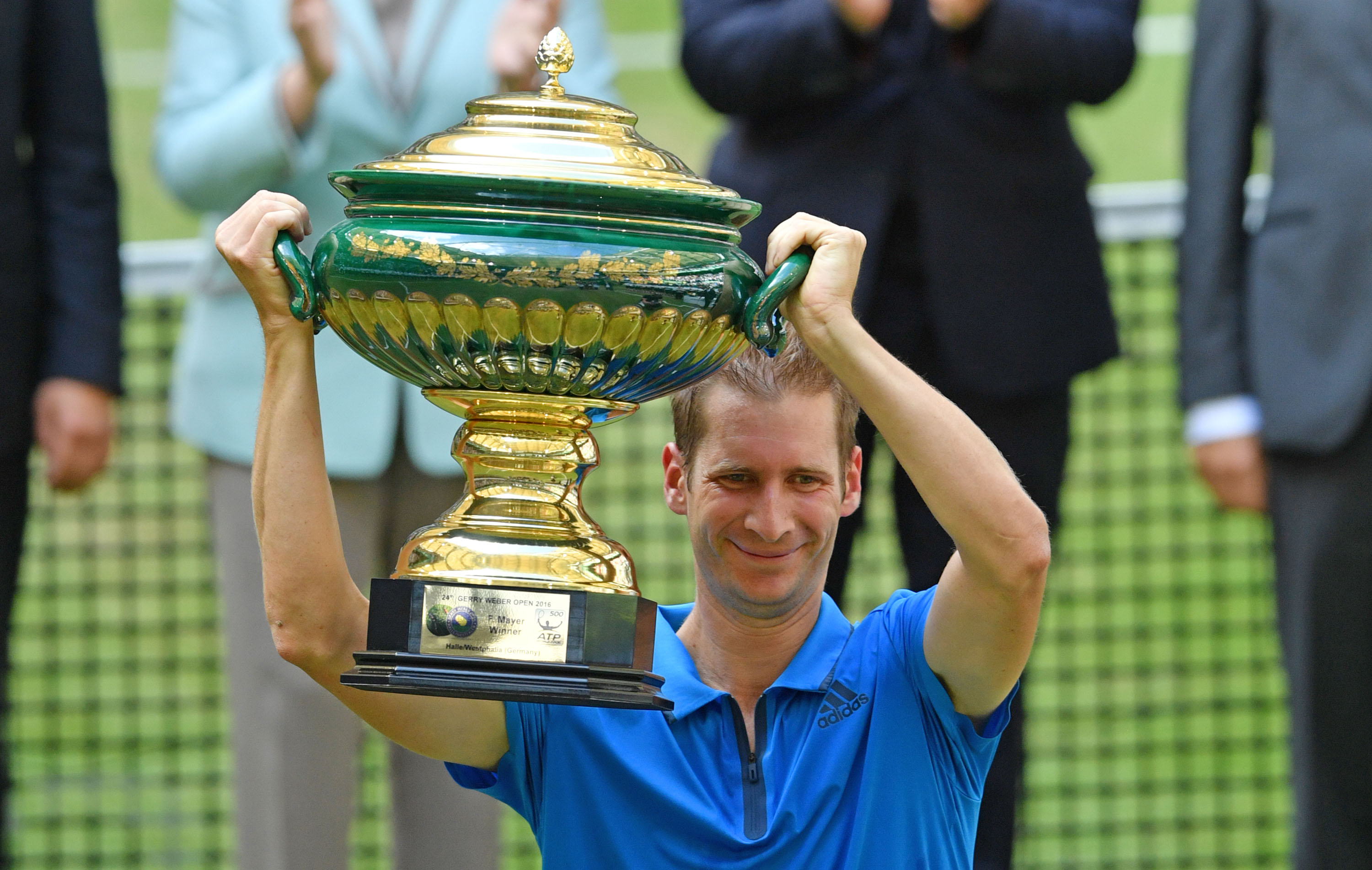 HALLE, GERMANY - JUNE 19:  Florian Mayer of Germany lifts the winners cup  after winning the final match of the Gerry Weber Open against Alexander Zverev of Germany at Gerry Weber Stadium on June 19, 2016 in Halle, Germany.  (Photo by Thomas Starke/Bongarts/Getty Images)
