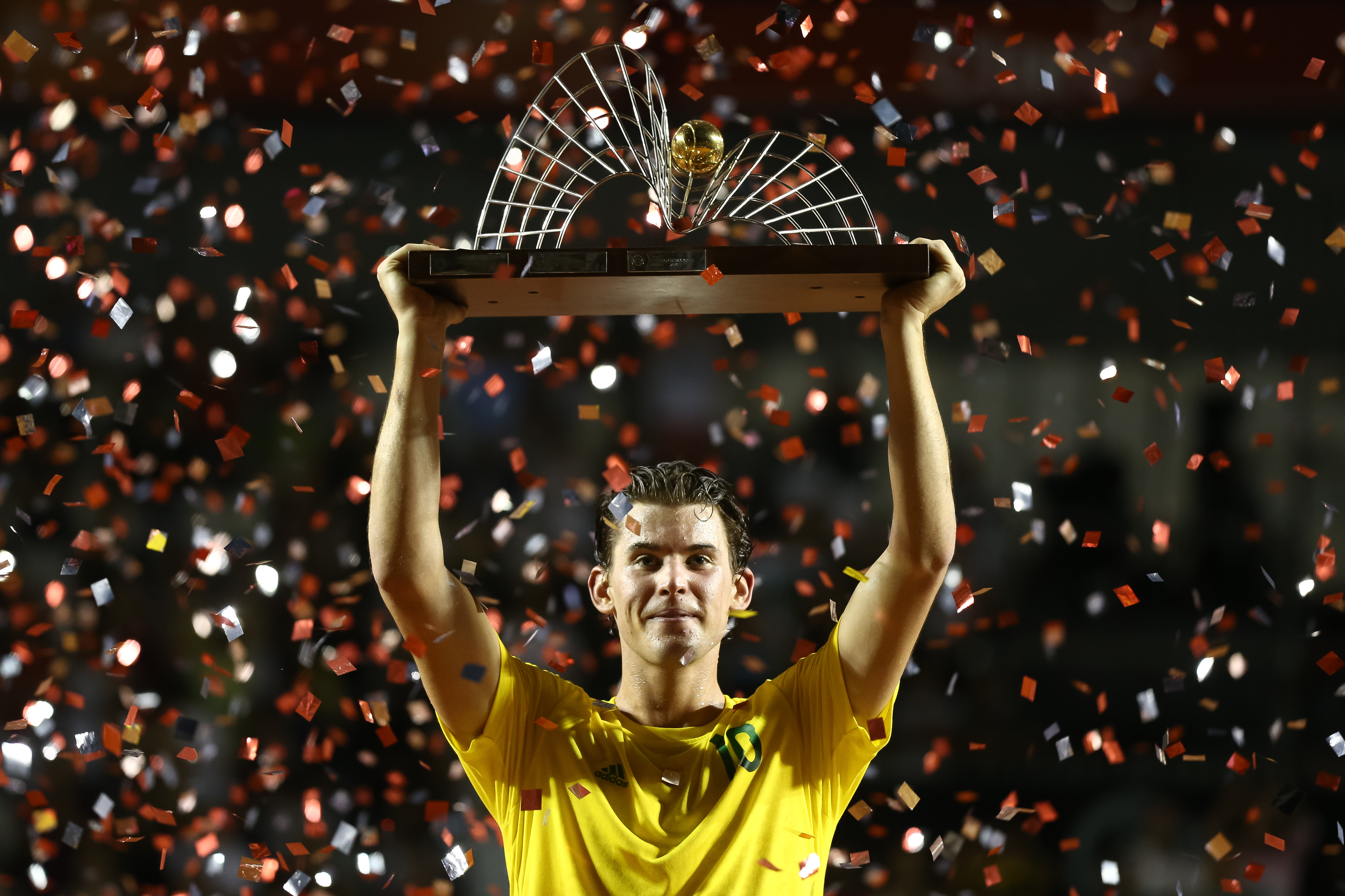 RIO DE JANEIRO, BRAZIL - FEBRUARY 26: Dominic Thiem of Austria raises his trophy after defeating Pablo Carreno Busta of Spain during the Final of the ATP Rio Open 2017 at Jockey Club Brasileiro on February 26, 2017 in Rio de Janeiro, Brazil. (Photo by Buda Mendes/Getty Images)