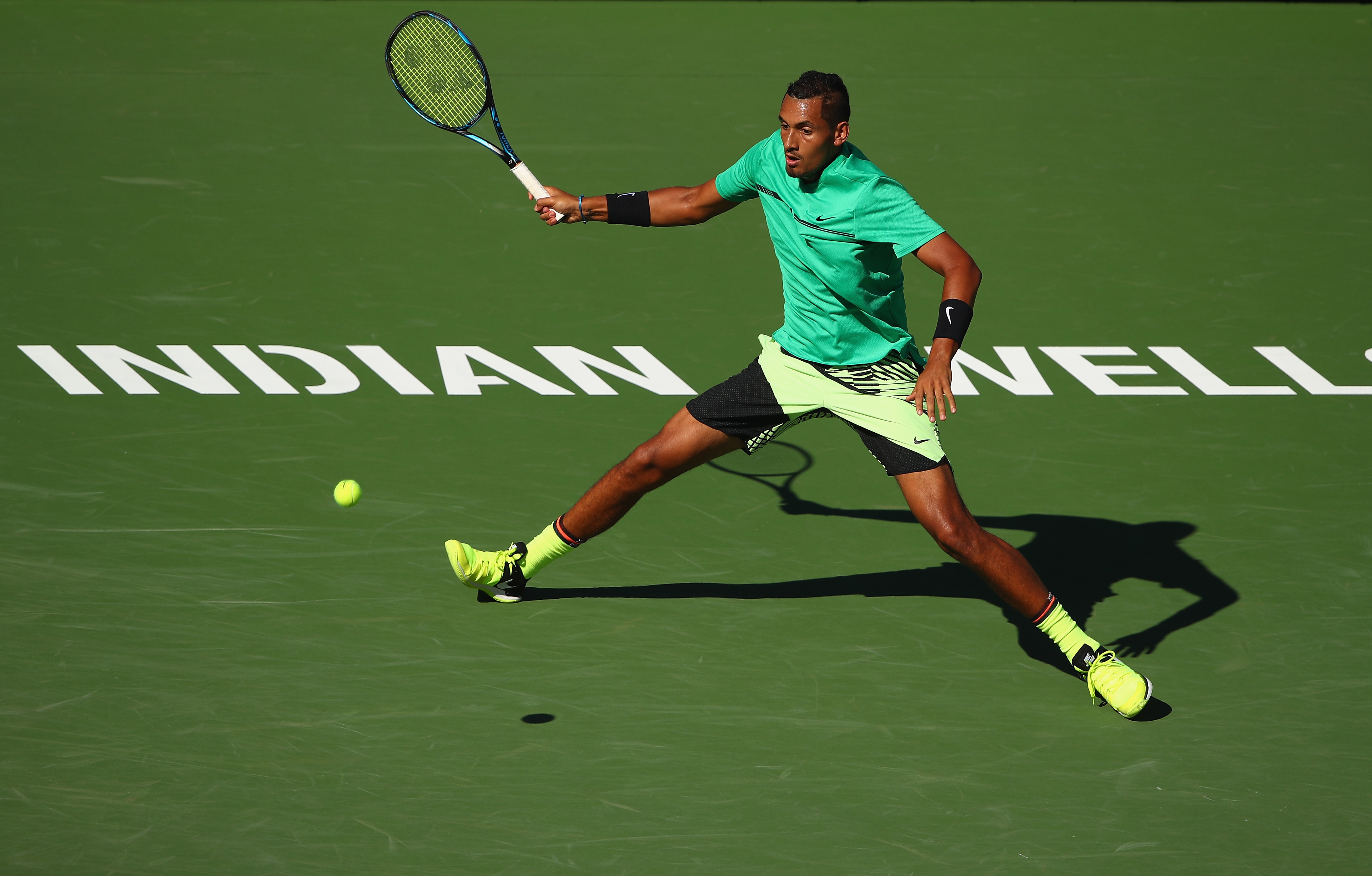 INDIAN WELLS, CA - MARCH 15: Nick Kyrgios of Australia plays a forehand during his straight set victory against Novak Djokovic of Serbia in their fourth round match during day ten of the BNP Paribas Open at Indian Wells Tennis Garden on March 15, 2017 in Indian Wells, California. (Photo by Clive Brunskill/Getty Images)