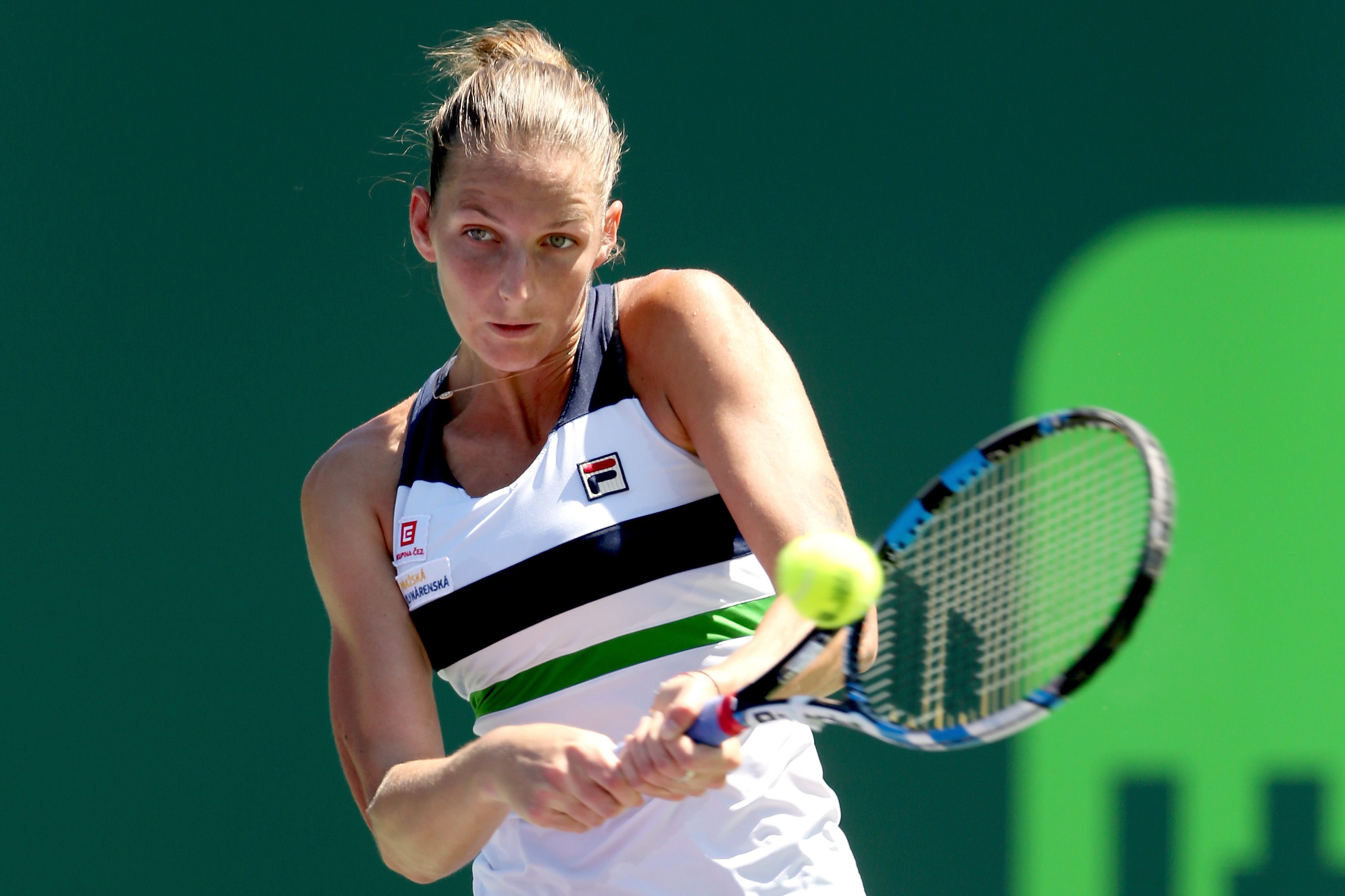 KEY BISCAYNE, FL - MARCH 28: Karolina Pliskova of Czech Republic returns a shot to Mirjana Lucic-Baroni of Croatia during the Miami Open at the Crandon Park Tennis Center on March 28, 2017 in Key Biscayne, Florida. (Photo by Matthew Stockman/Getty Images)