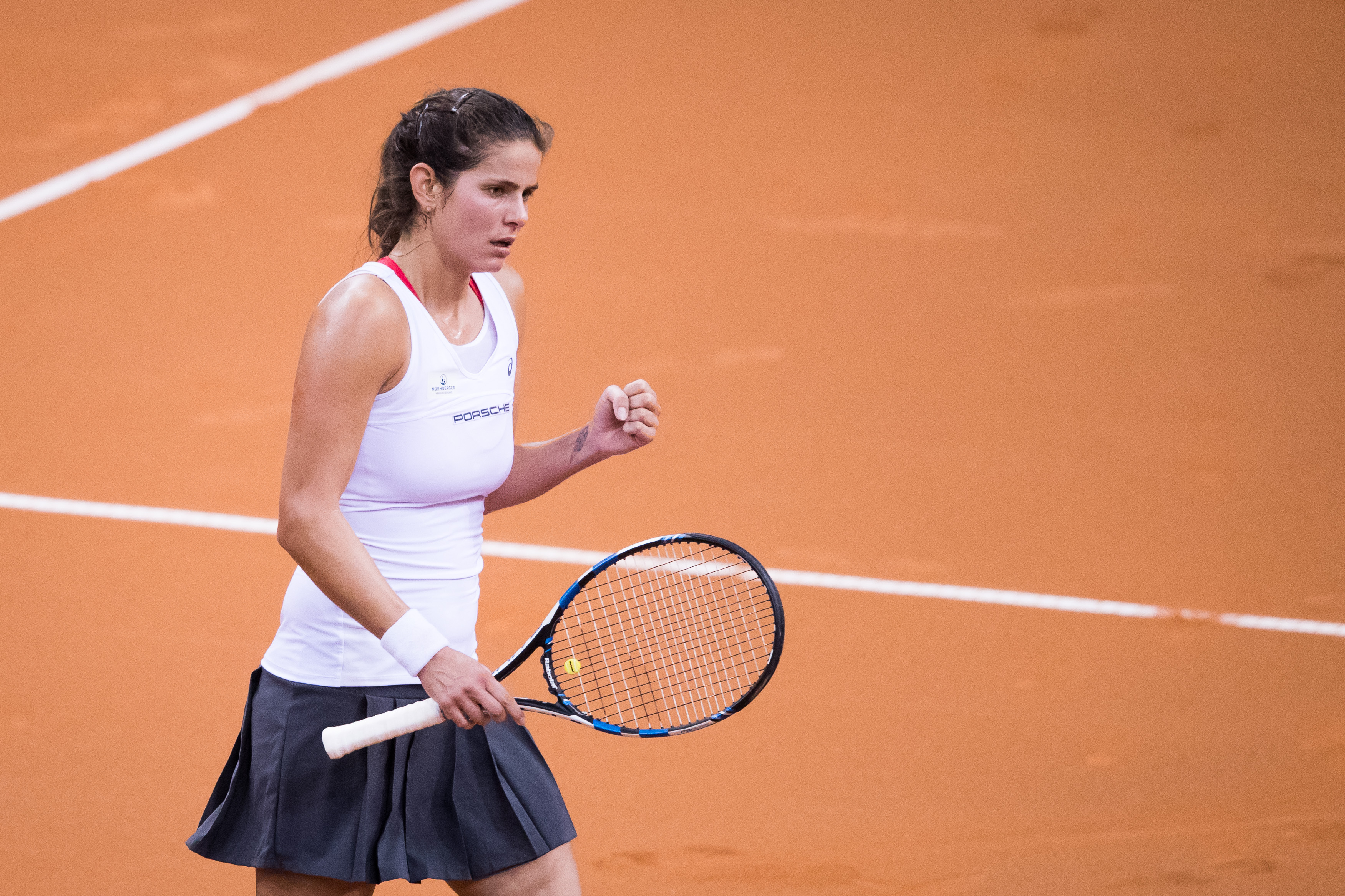 STUTTGART, GERMANY - APRIL 22: Julia Goerges of Germany celebrates a point against Elina Svitolina of Ukraine during the FedCup World Group Play-Off Match between Germany and Ukraine at Porsche Arena on April 22, 2017 in Stuttgart, Germany. (Photo by Simon Hofmann/Bongarts/Getty Images)