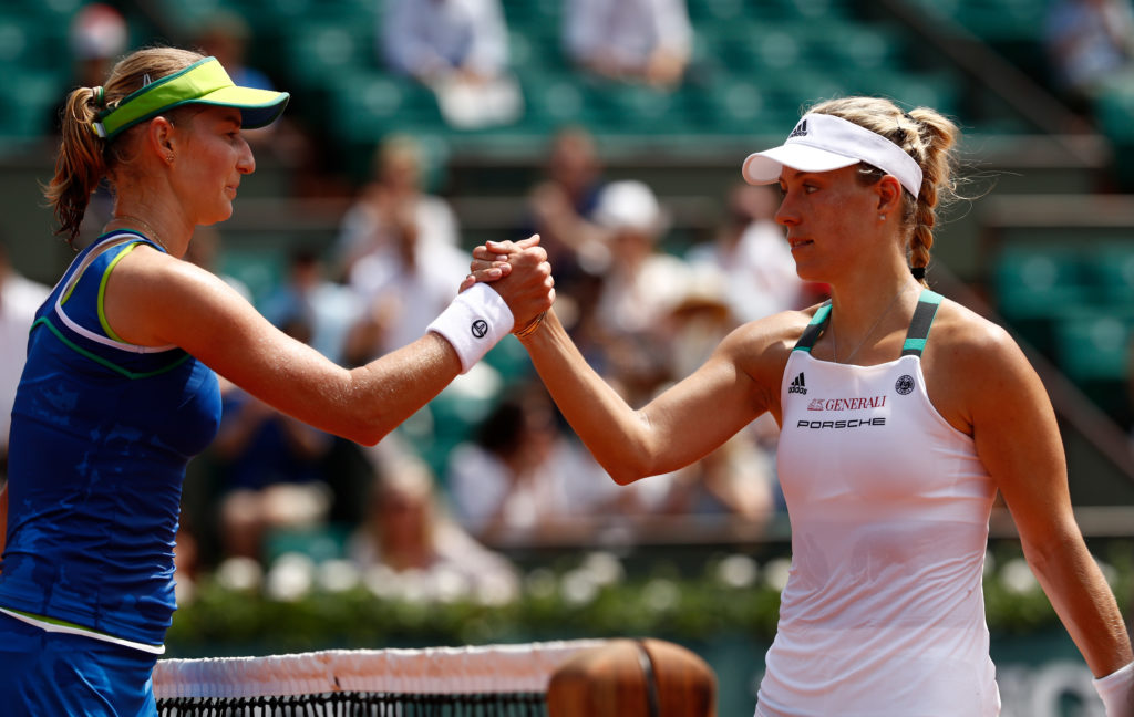 PARIS, FRANCE - MAY 28: A victorius Ekaterina Makarova of Russia (L) shakes hands with Angelique Kerber of Germany after the ladies singles first round match on day one of the 2017 French Open at Roland Garros on May 28, 2017 in Paris, France. (Photo by Adam Pretty/Getty Images)