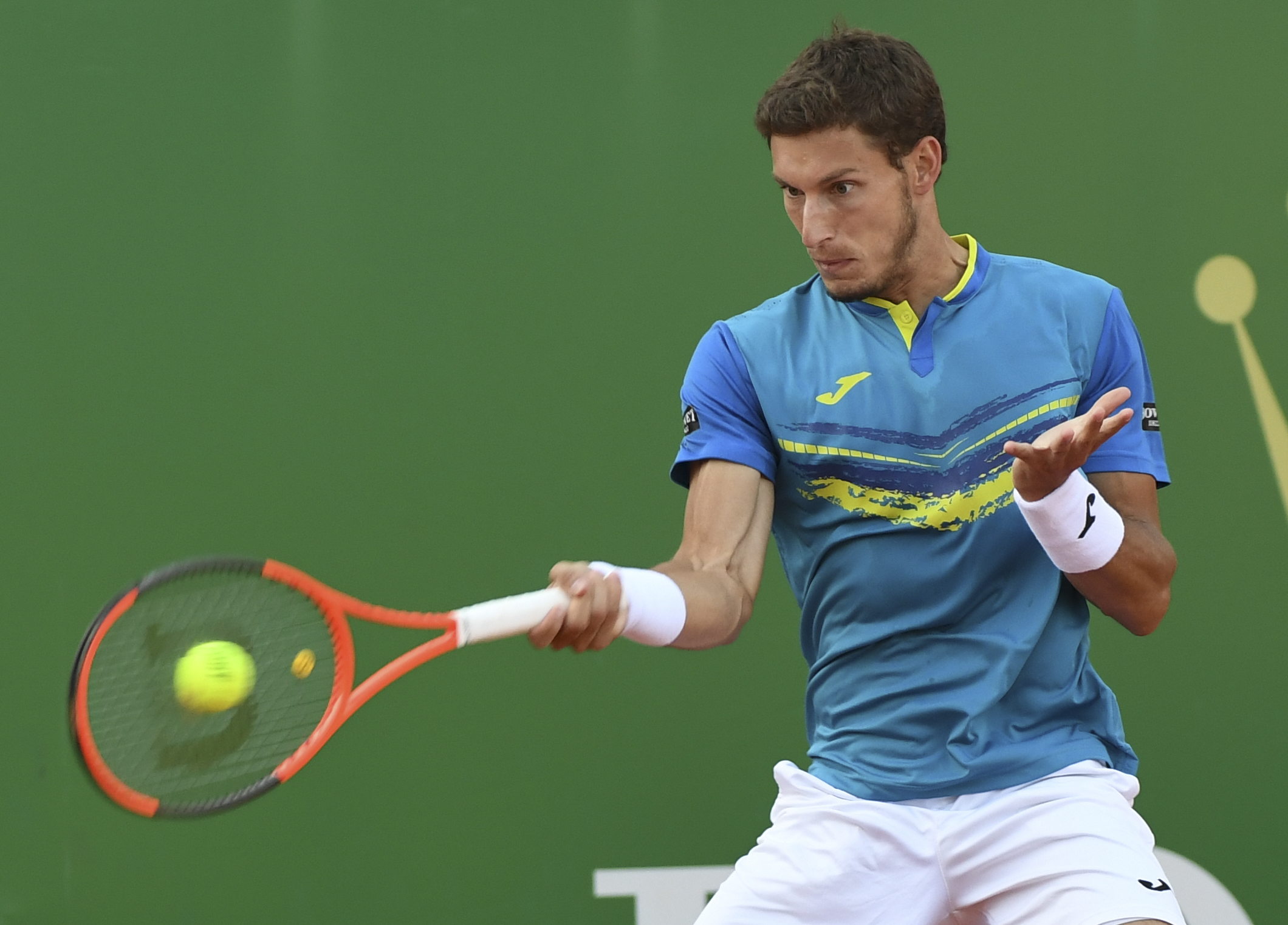 Spain's Pablo Carreno Busta returns the ball to Serbia's Novak Djokovic during the Monte-Carlo ATP Masters Series tennis tournament on April 20, 2017 in Monaco. / AFP PHOTO / Yann COATSALIOU (Photo credit should read YANN COATSALIOU/AFP/Getty Images)
