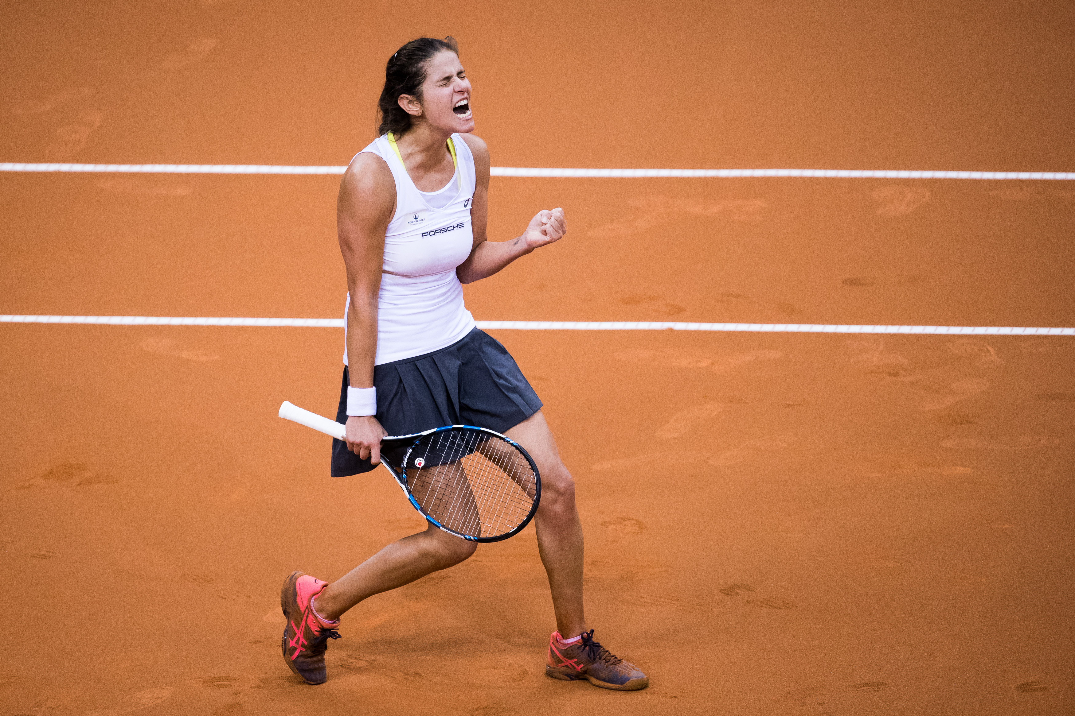 STUTTGART, GERMANY - APRIL 23: Julia Goerges of Germany celebrates victory against Lesia Tsurenko of Ukraine during the FedCup World Group Play-Off match between Germany and Ukraine at Porsche Arena on April 23, 2017 in Stuttgart, Germany. (Photo by Simon Hofmann/Bongarts/Getty Images)