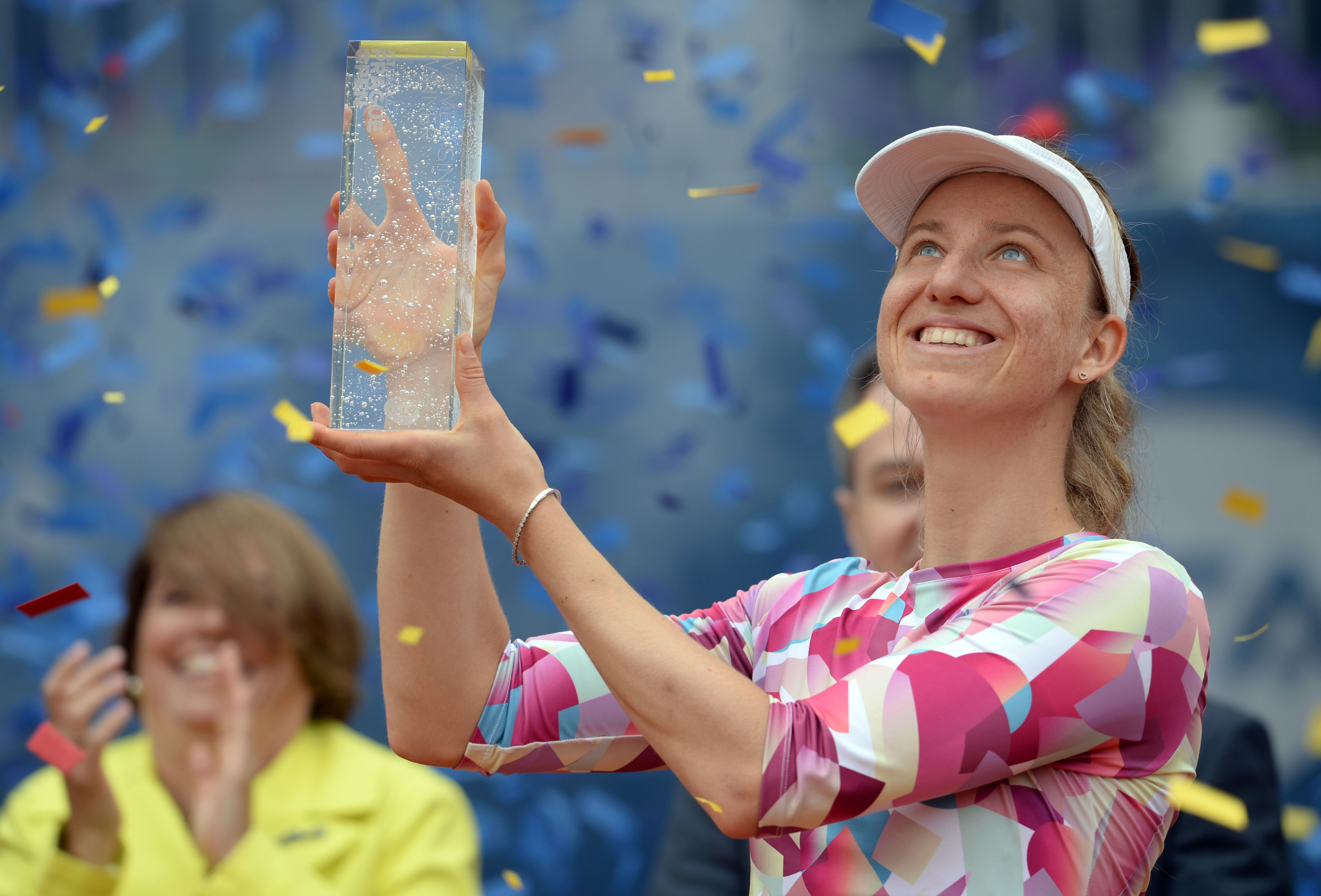 German Mona Barthel poses with the trophy after winning over Czech's Kristyna Pliskova during their final tennis match at the Prague Open on May 6, 2017 in Prague. / AFP PHOTO / Michal Cizek (Photo credit should read MICHAL CIZEK/AFP/Getty Images)