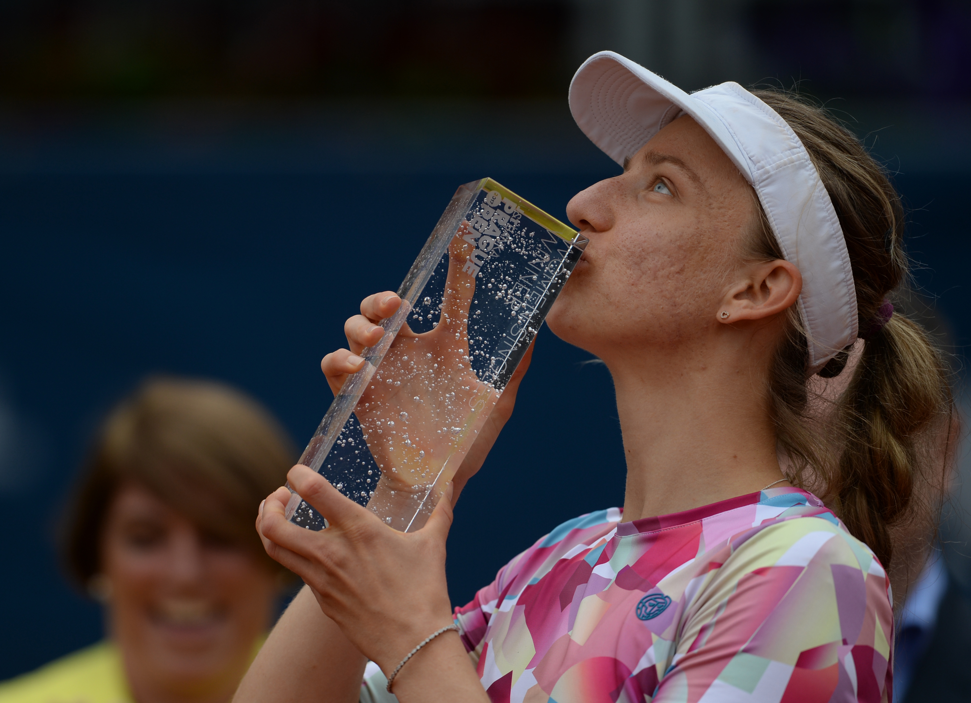 German Mona Barthel kisses the trophy after winning over Czech's Kristyna Pliskova during their final tennis match at the Prague Open on May 6, 2017 in Prague. / AFP PHOTO / Michal Cizek (Photo credit should read MICHAL CIZEK/AFP/Getty Images)