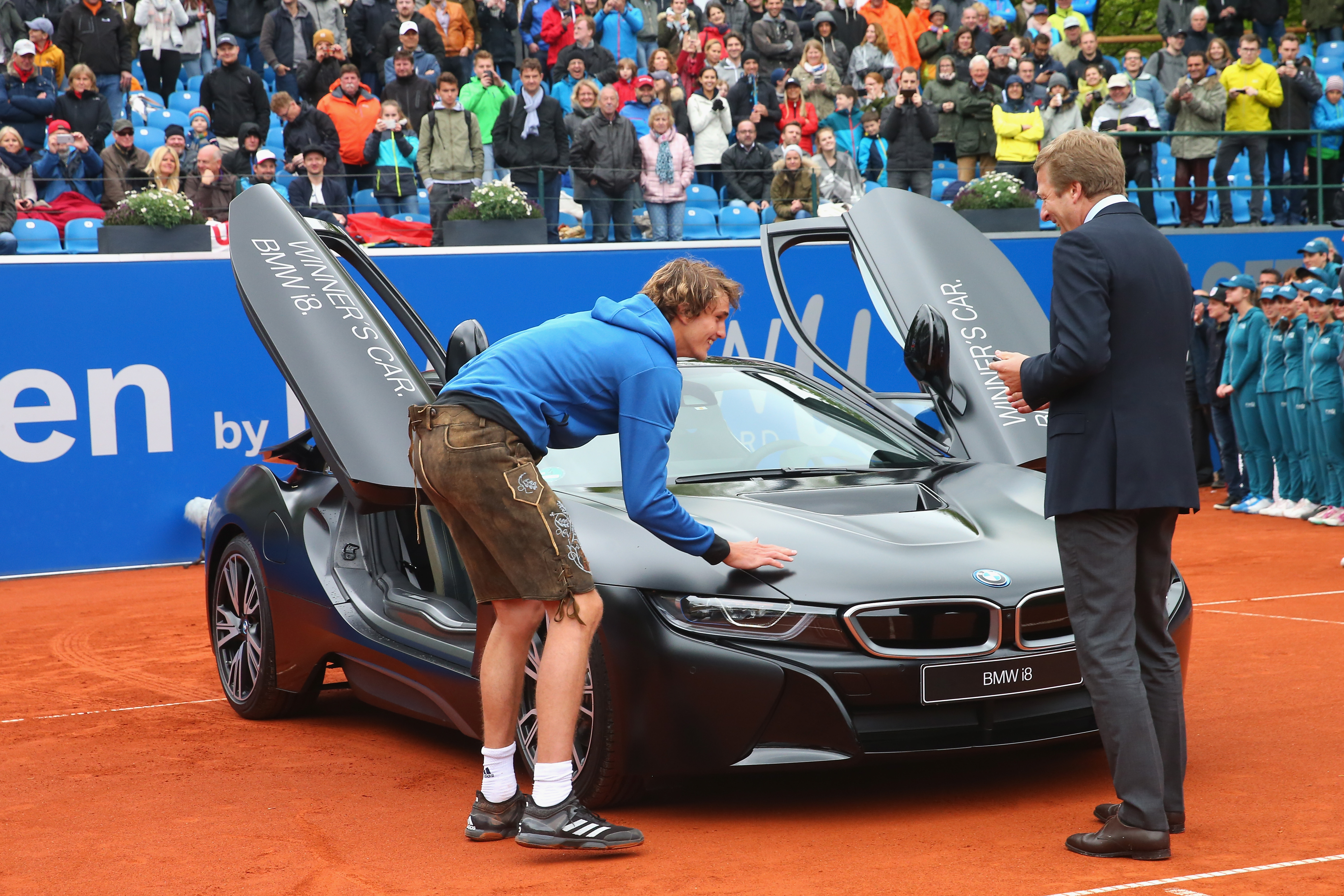 MUNICH, GERMANY - MAY 07: Alexander Zverev of Germany celebrates with winner's car BMW i8 after winning his finale match against Guido Pella of Argentina of the 102. BMW Open by FWU at Iphitos tennis club on May 7, 2017 in Munich, Germany. (Photo by Alexander Hassenstein/Getty Images For BMW)