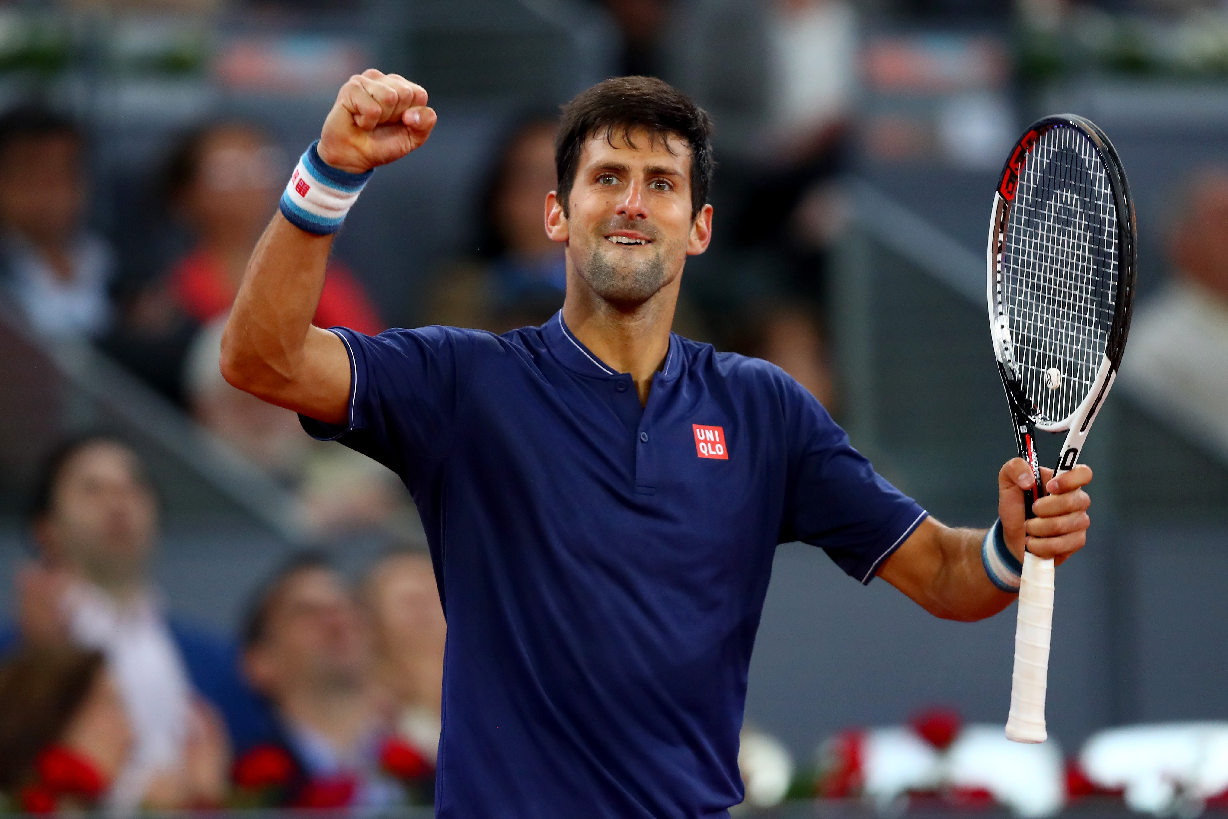 MADRID, SPAIN - MAY 11: Novak Djokovic of Serbia celebrates his victory over Feliciano Lopez of Spain on day six of the Mutua Madrid Open tennis at La Caja Magica on May 11, 2017 in Madrid, Spain. (Photo by Clive Rose/Getty Images)