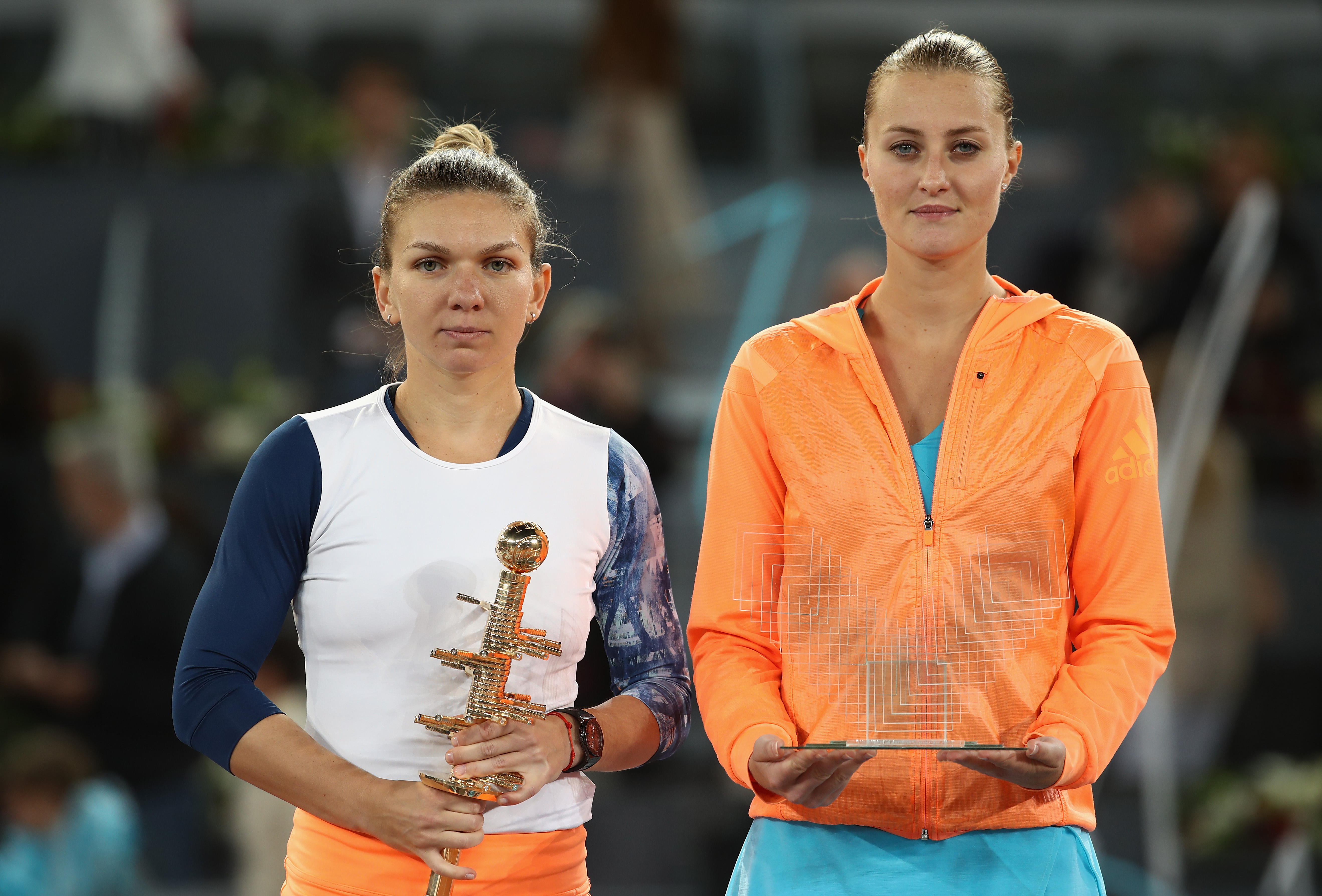 MADRID, SPAIN - MAY 13: Simona Halep of Romania with the winners trophy next to runner up Kristina Mladenovic of France after the final during day eight of the Mutua Madrid Open tennis at La Caja Magica on May 13, 2017 in Madrid, Spain. (Photo by Julian Finney/Getty Images)