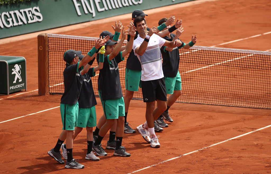 PARIS, FRANCE - MAY 29: Novak Djokovic of Serbia celebrates with the ball boys after beating Marcel Granollers of Spain in their first round match on day two of the 2017 French Open at Roland Garros on May 29, 2017 in Paris, France. (Photo by Julian Finney/Getty Images)