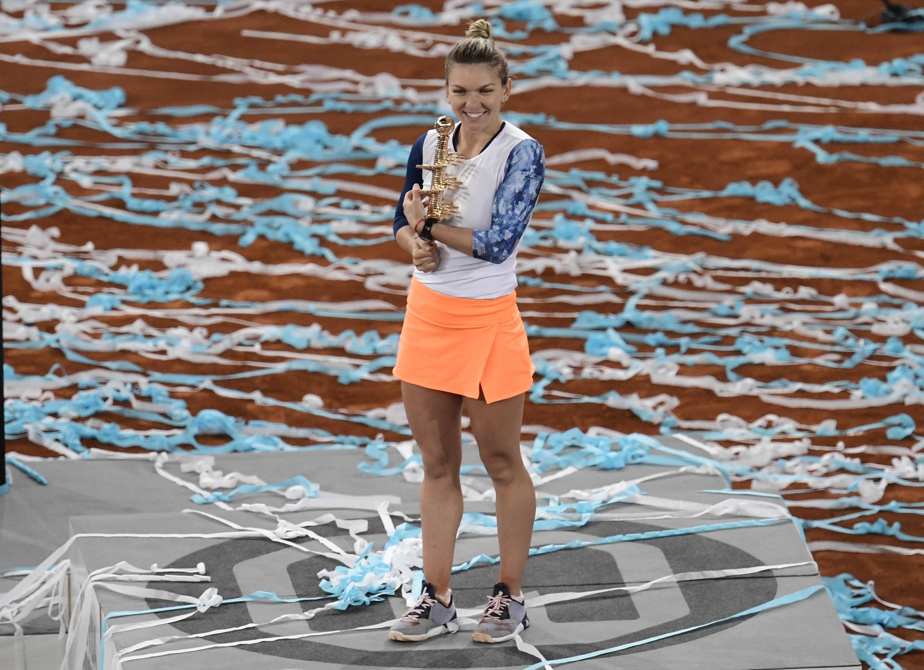 Romanian tennis player Simona Halep poses with her trophy as she celebrates her victory over French tennis player Kristina Mladenovic after the WTA Madrid Open final in Madrid, on May 13, 2017. Halep won 7-5, 6-7 and 6-2. / AFP PHOTO / JAVIER SORIANO (Photo credit should read JAVIER SORIANO/AFP/Getty Images)