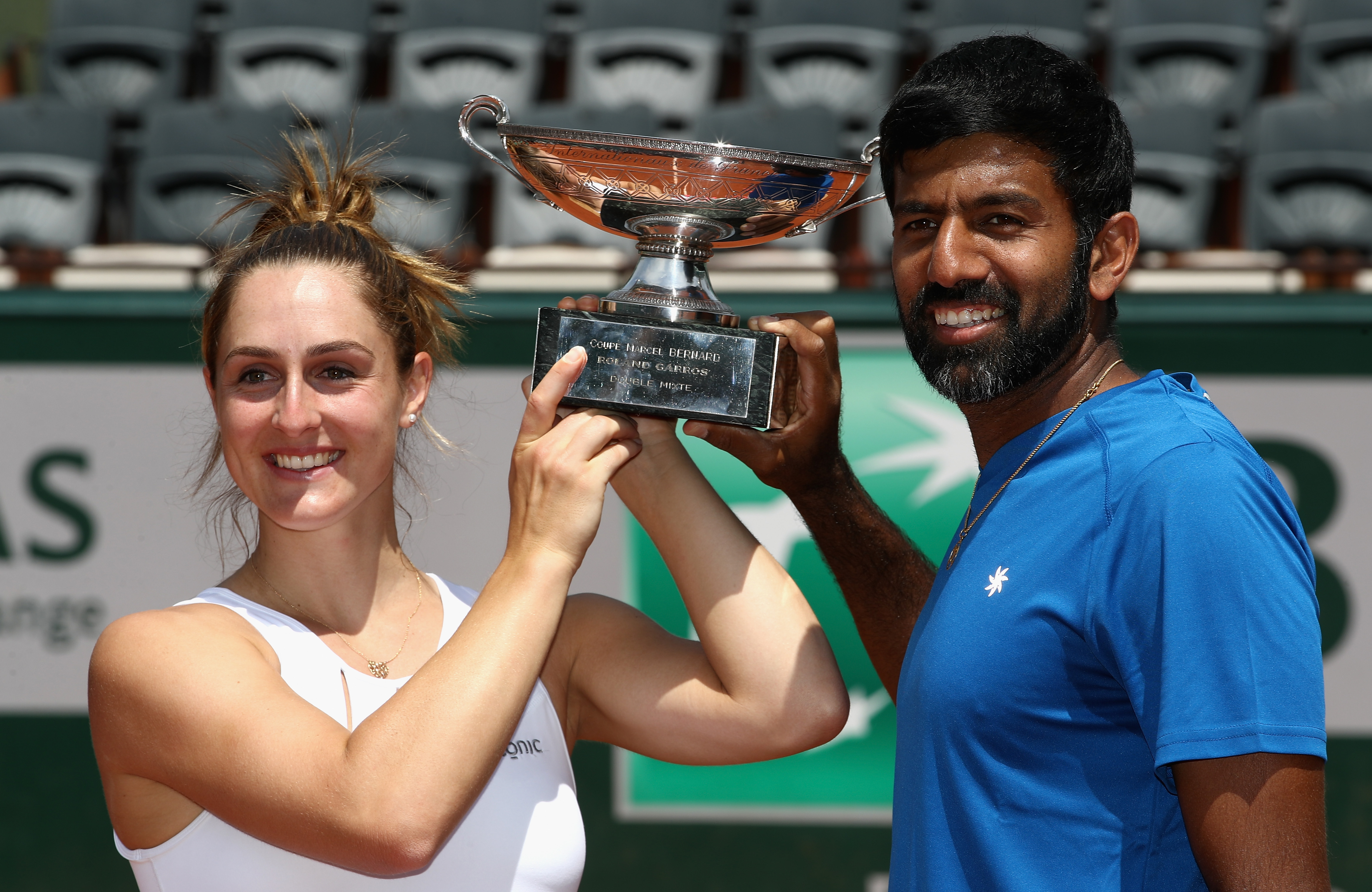 PARIS, FRANCE - JUNE 08:  Gabriela Dabrowski of Canada and Rohan Bopanna of India celebrate with the trophy following victory in the mixed doubles final against Anna-Lena Groenefeld of Germany and Robert Farah of Columbia on day twelve of the 2017 French Open at Roland Garros on June 8, 2017 in Paris, France.  (Photo by Julian Finney/Getty Images)