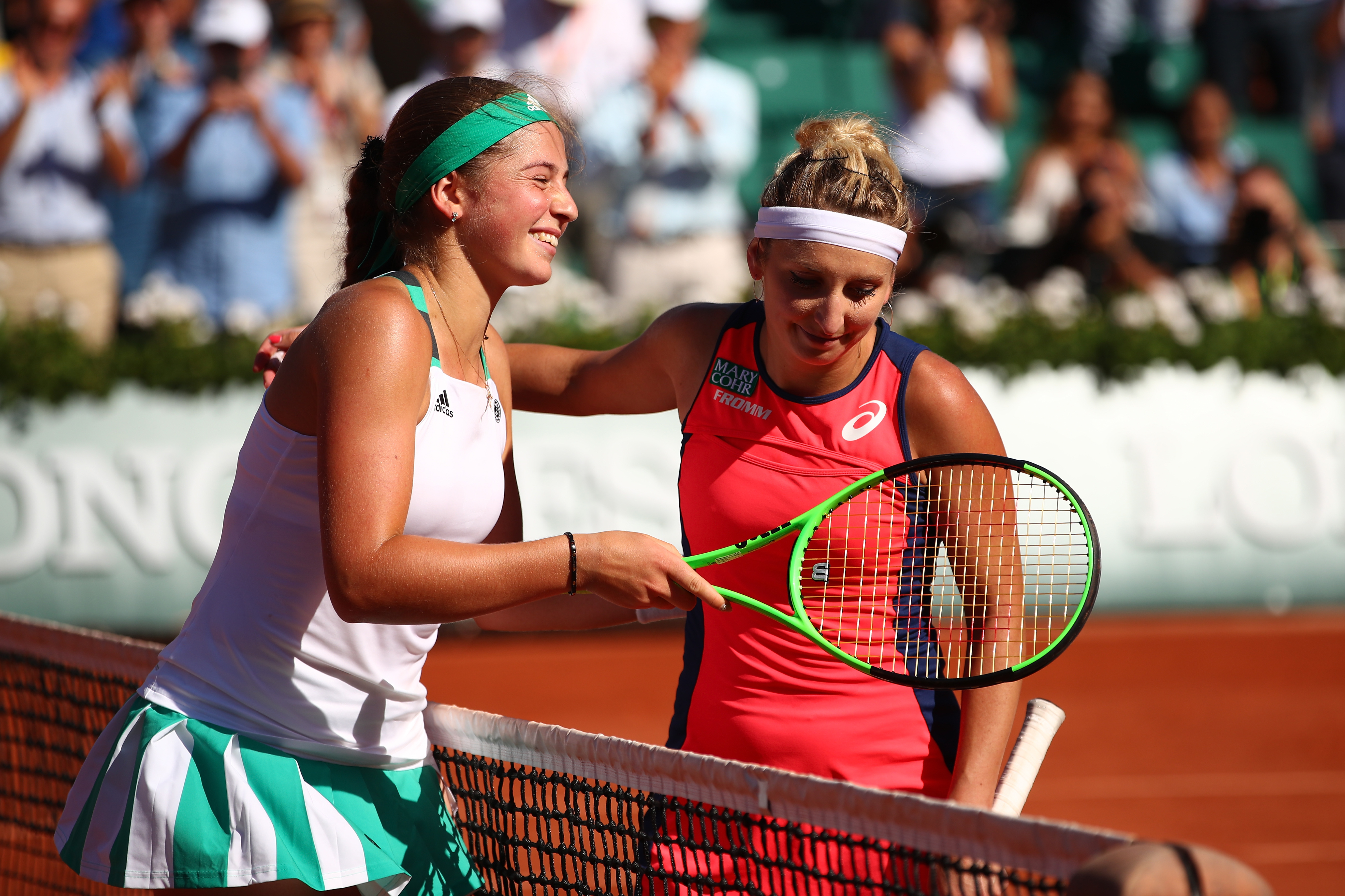 PARIS, FRANCE - JUNE 08: (L-R) Jelena Ostapenko of Latvia shakes hands with Timea Bacsinszky of Switzerland following her victory during their ladies semi final match on day twelve of the 2017 French Open at Roland Garros on June 8, 2017 in Paris, France. (Photo by Clive Brunskill/Getty Images)