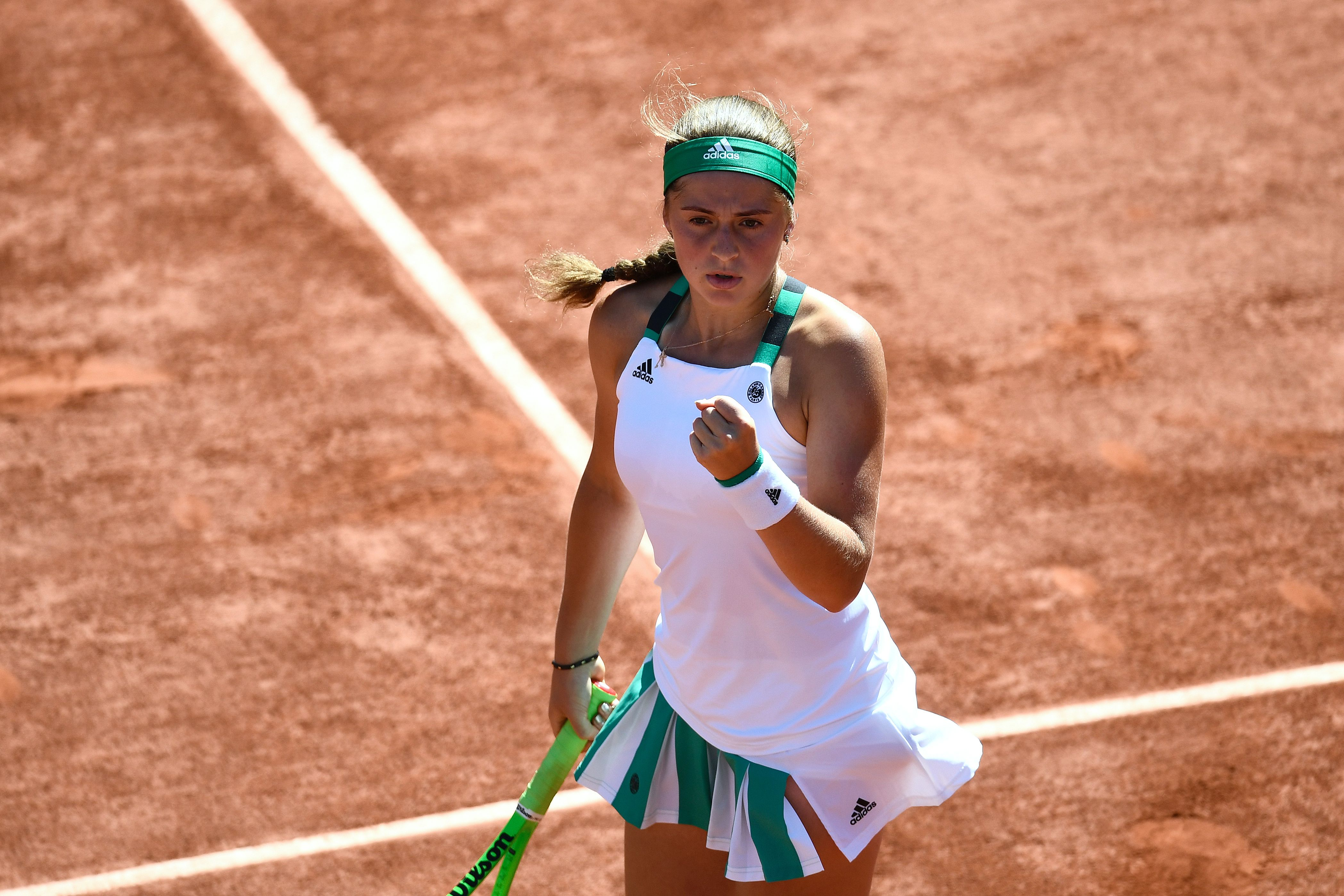 Latvia's Jelena Ostapenko celebrates after scoring a point during her semifinal tennis match against Switzerland's Timea Bacsinszky at the Roland Garros 2017 French Open on June 8, 2017 in Paris. / AFP PHOTO / CHRISTOPHE SIMON (Photo credit should read CHRISTOPHE SIMON/AFP/Getty Images)