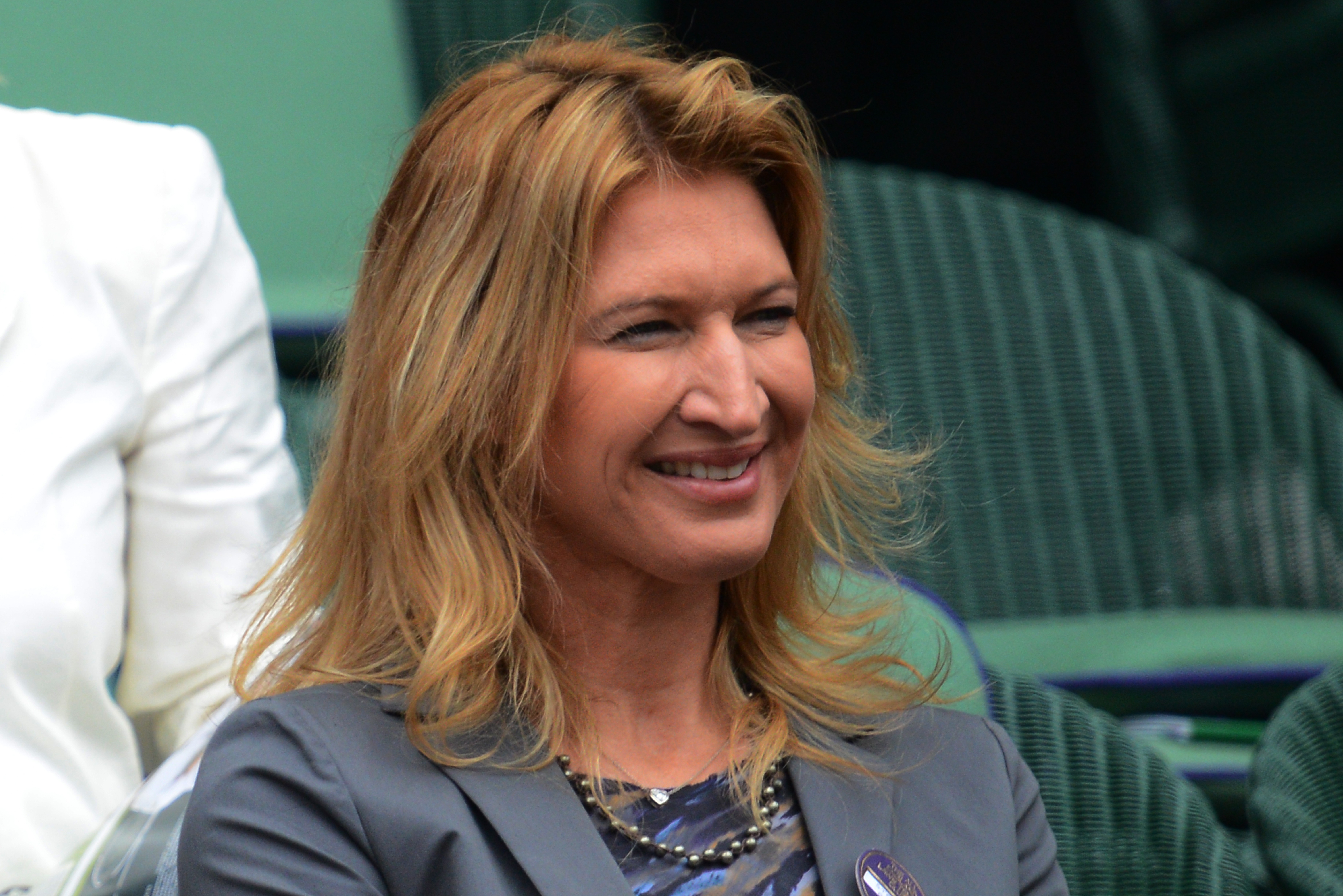 Former German tennis player Steffi Graf in the Royal Box on Centre Court on day nine of the 2012 Wimbledon Championships tennis tournament at the All England Tennis Club in Wimbledon, southwest London, on July 4, 2012. AFP PHOTO / LEON NEAL RESTRICTED TO EDITORIAL USE (Photo credit should read LEON NEAL/AFP/GettyImages)