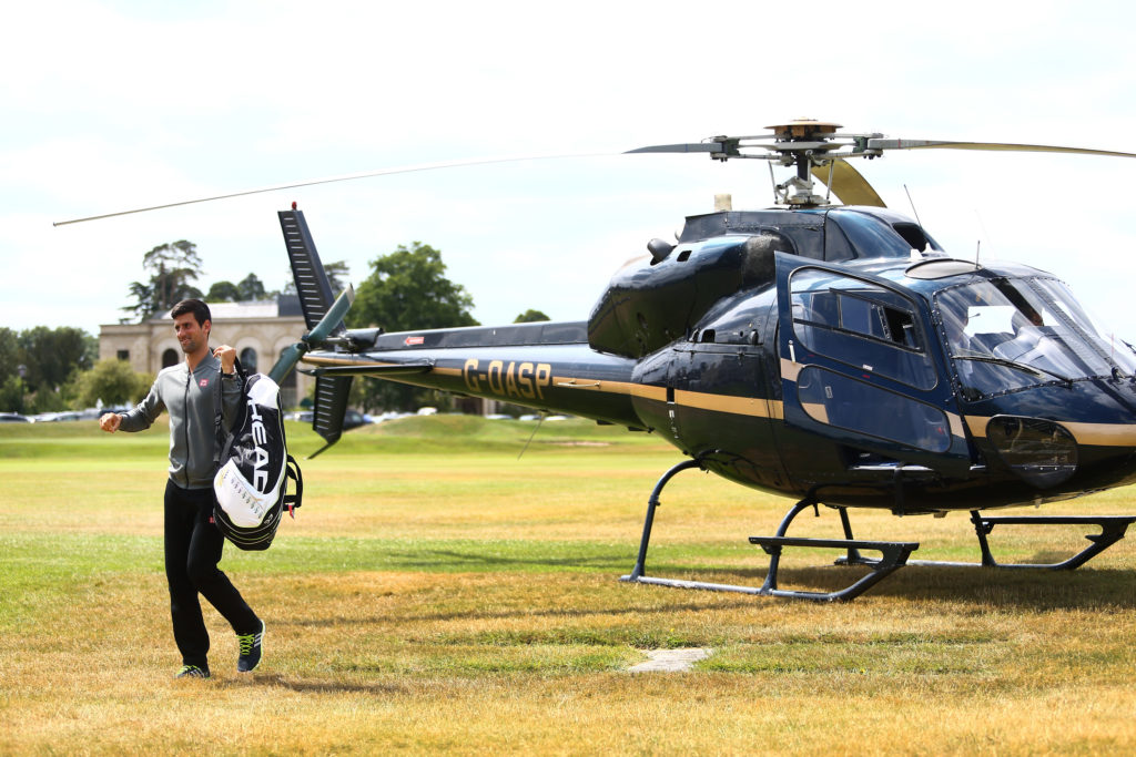 STOKE POGES, ENGLAND - JUNE 25:  Novak Djokovic of Serbia arrives by helicopter ahead of his match against Richard Gasquets of France during Day 3 of The Boodles Tennis Event at Stoke Park on June 25, 2015 in Stoke Poges, England.  (Photo by Jordan Mansfield/Getty Images)