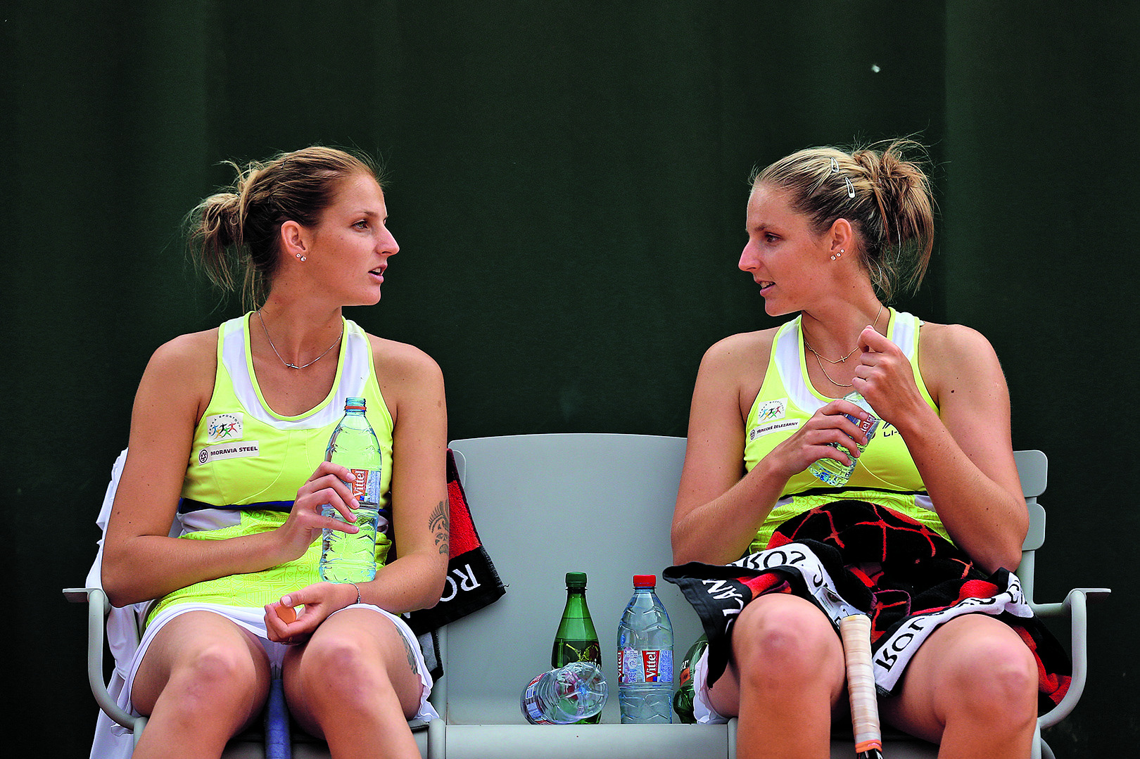 PARIS, FRANCE - MAY 28: Karolina Pliskova of Czech Republic and Kristyna Pliskova of Czech Republic talk during a break in play in the Women's Doubles match against Ajla Tomljanovic of Australia and Jarmila Gajdosova on day five of the 2015 French Open at Roland Garros on May 28, 2015 in Paris, France. (Photo by Clive Brunskill/Getty Images)