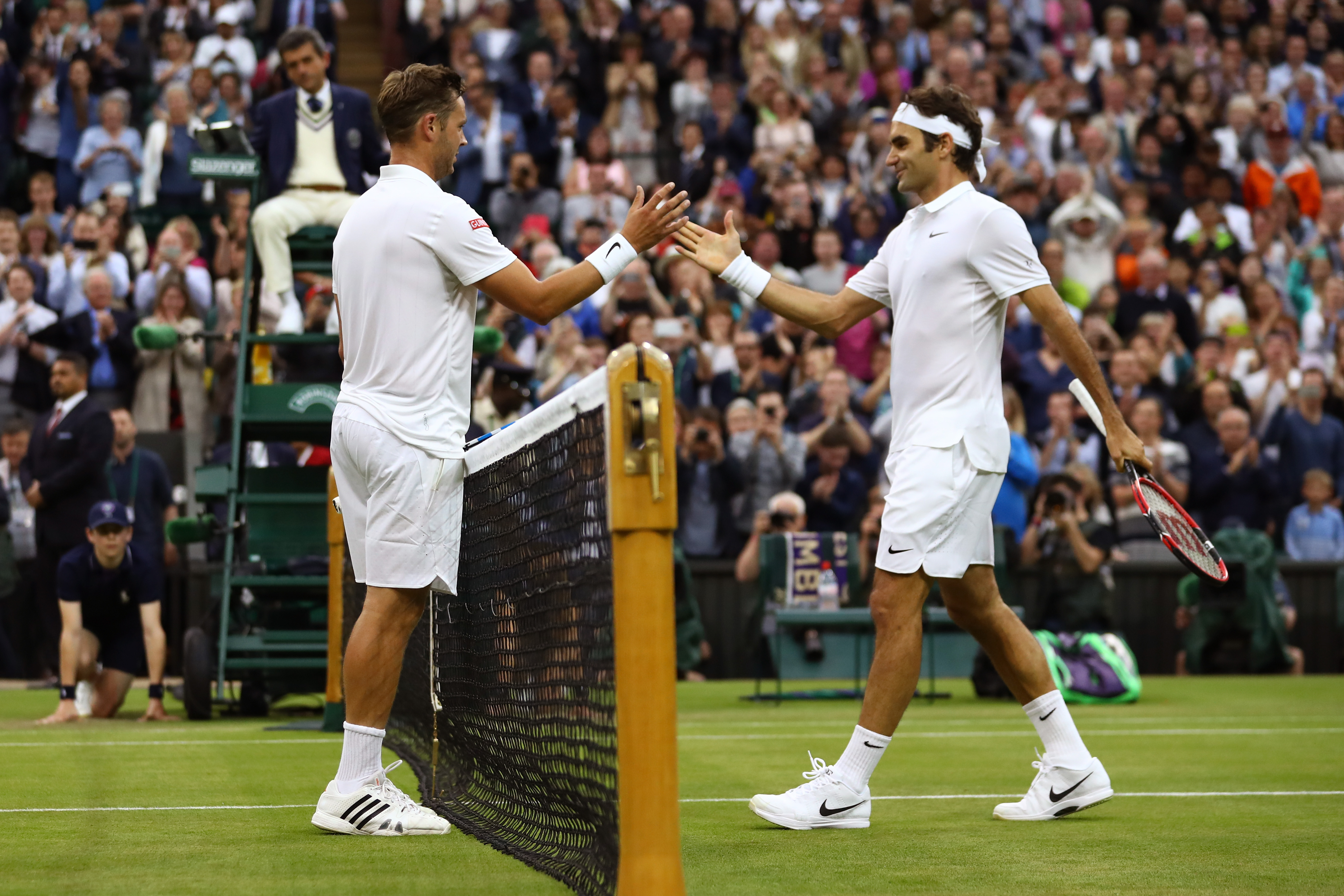 LONDON, ENGLAND - JUNE 29: Marcus Willis of Great Britain and Roger Federer of Switzerland shake hands following the Men's Singles second round match on day three of the Wimbledon Lawn Tennis Championships at the All England Lawn Tennis and Croquet Club on June 29, 2016 in London, England. (Photo by Julian Finney/Getty Images)