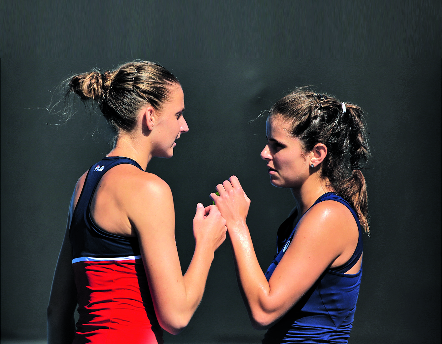 MELBOURNE, AUSTRALIA - JANUARY 19: Karolina Pliskova of the Czech Republic high fives Julia Goerges of Germany in their first match against Andreja Klepac of of Slovenia and Maria Jose Martinez Sanchez on day four of the 2017 Australian Open at Melbourne Park on January 19, 2017 in Melbourne, Australia. (Photo by Michael Dodge/Getty Images)