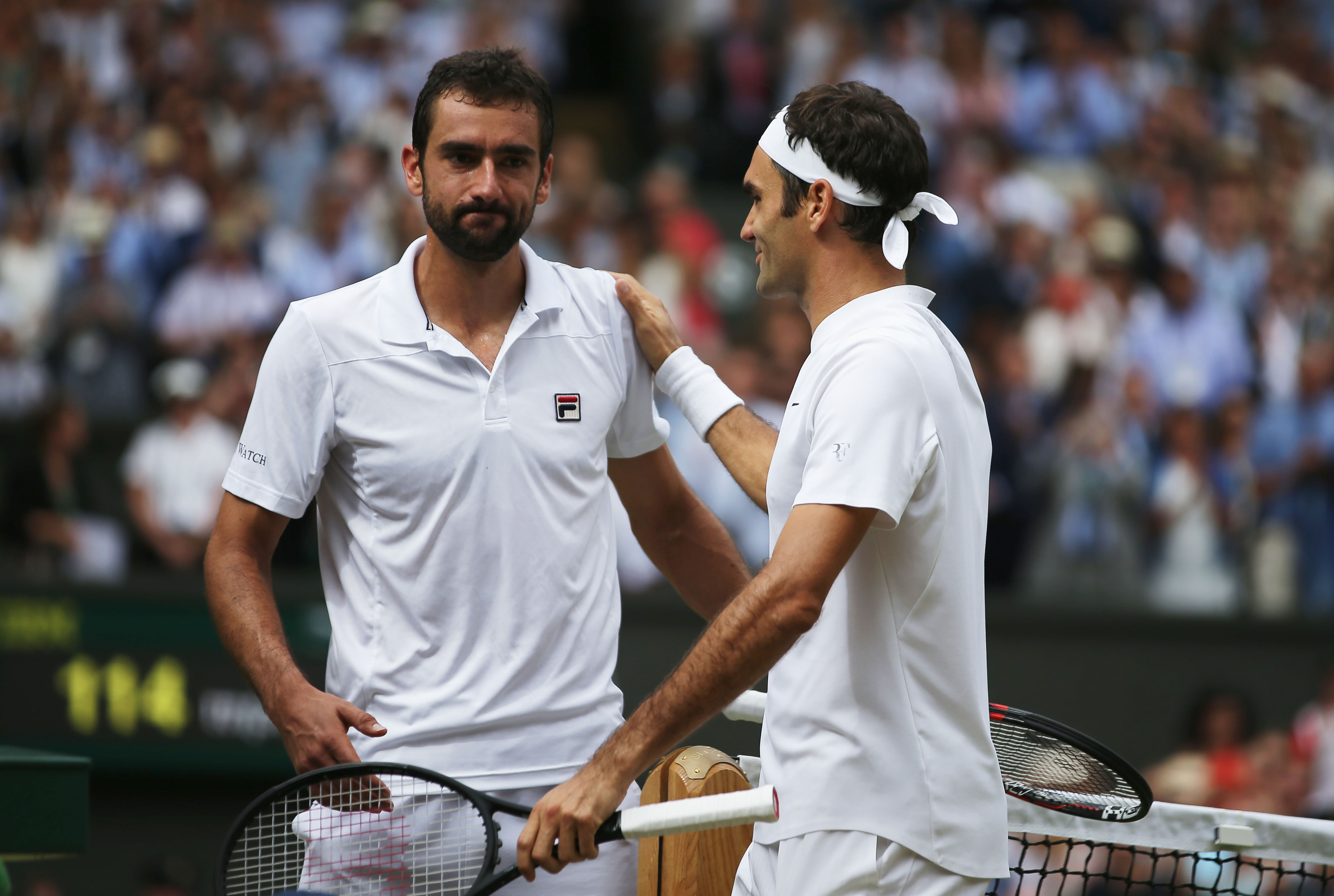 LONDON, ENGLAND - JULY 16: Roger Federer of Switzerland and Marin Cilic of Croatia shake hands after the Gentlemen's Singles final on day thirteen of the Wimbledon Lawn Tennis Championships at the All England Lawn Tennis and Croquet Club at Wimbledon on July 16, 2017 in London, England. (Photo by Daniel Leal-Olivas - Pool/Getty Images)